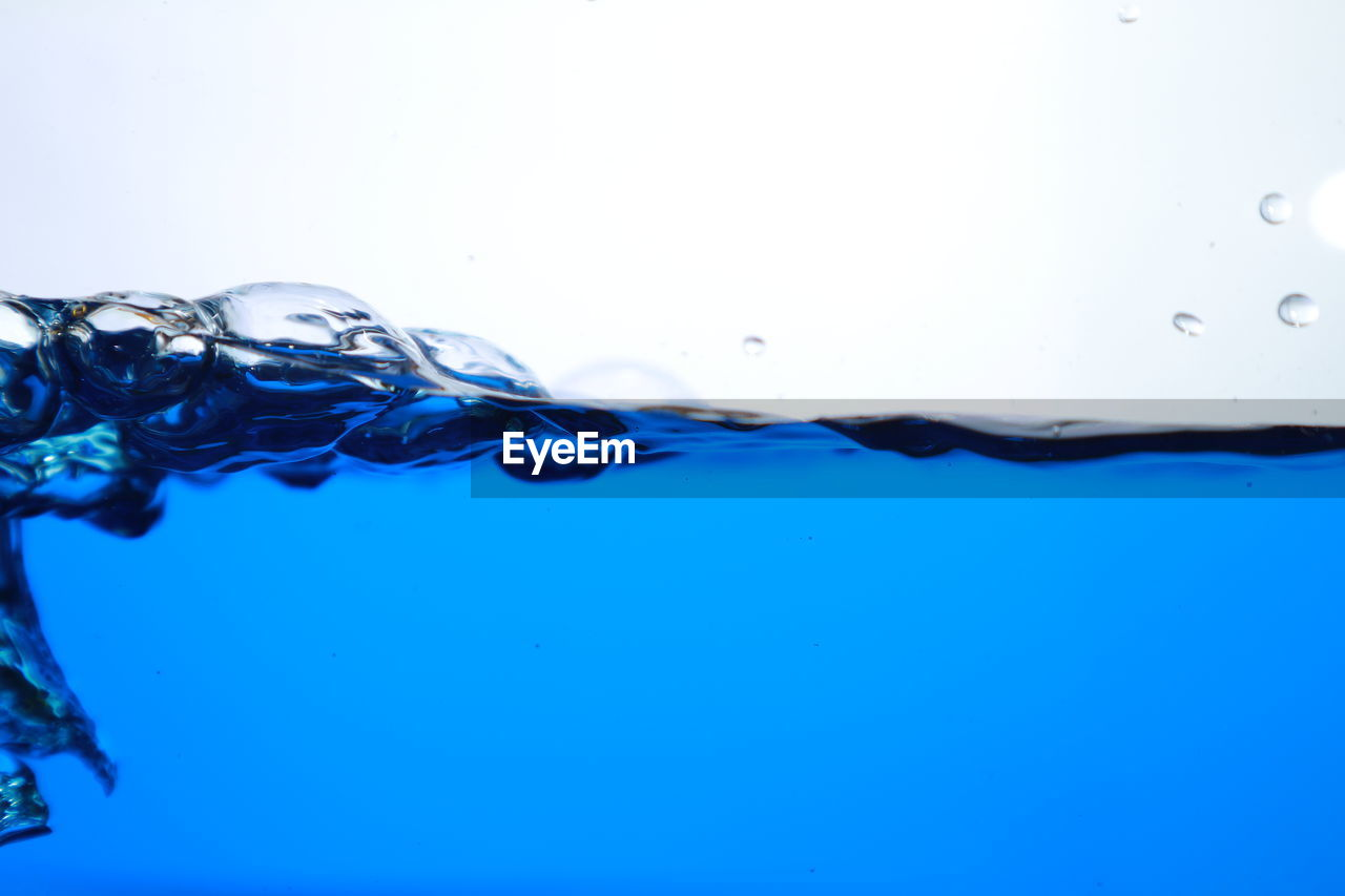 blue, water, no people, nature, close-up, copy space, motion, studio shot, indoors, drop, transparent, bubble, underwater, purity, reflection, sea, undersea, food and drink