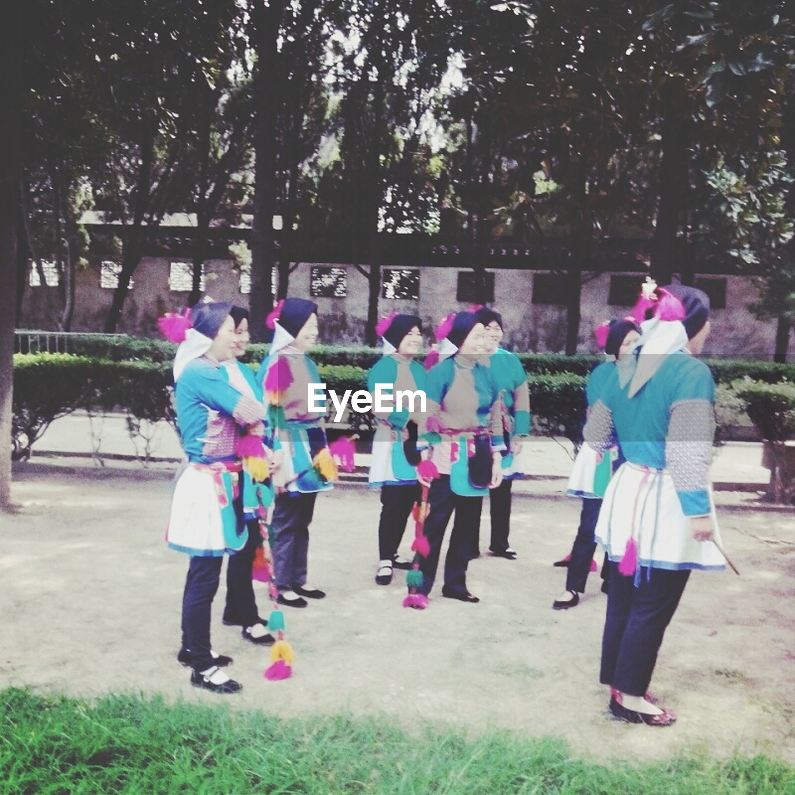 full length, lifestyles, leisure activity, person, rear view, casual clothing, walking, men, park - man made space, tree, grass, girls, togetherness, childhood, umbrella, field, standing, day, outdoors