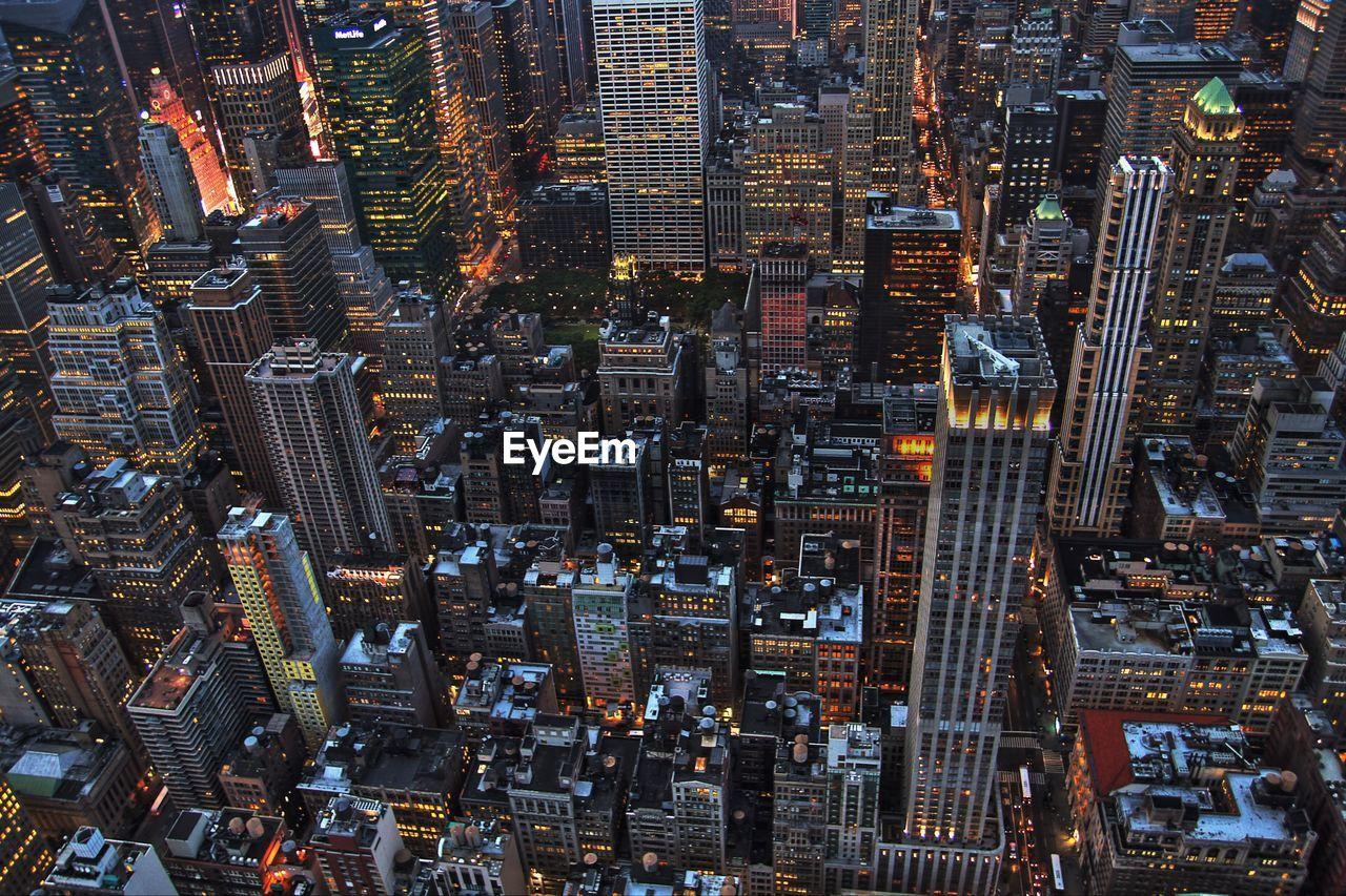 Full Frame Shot Of Illuminated Cityscape At Dusk
