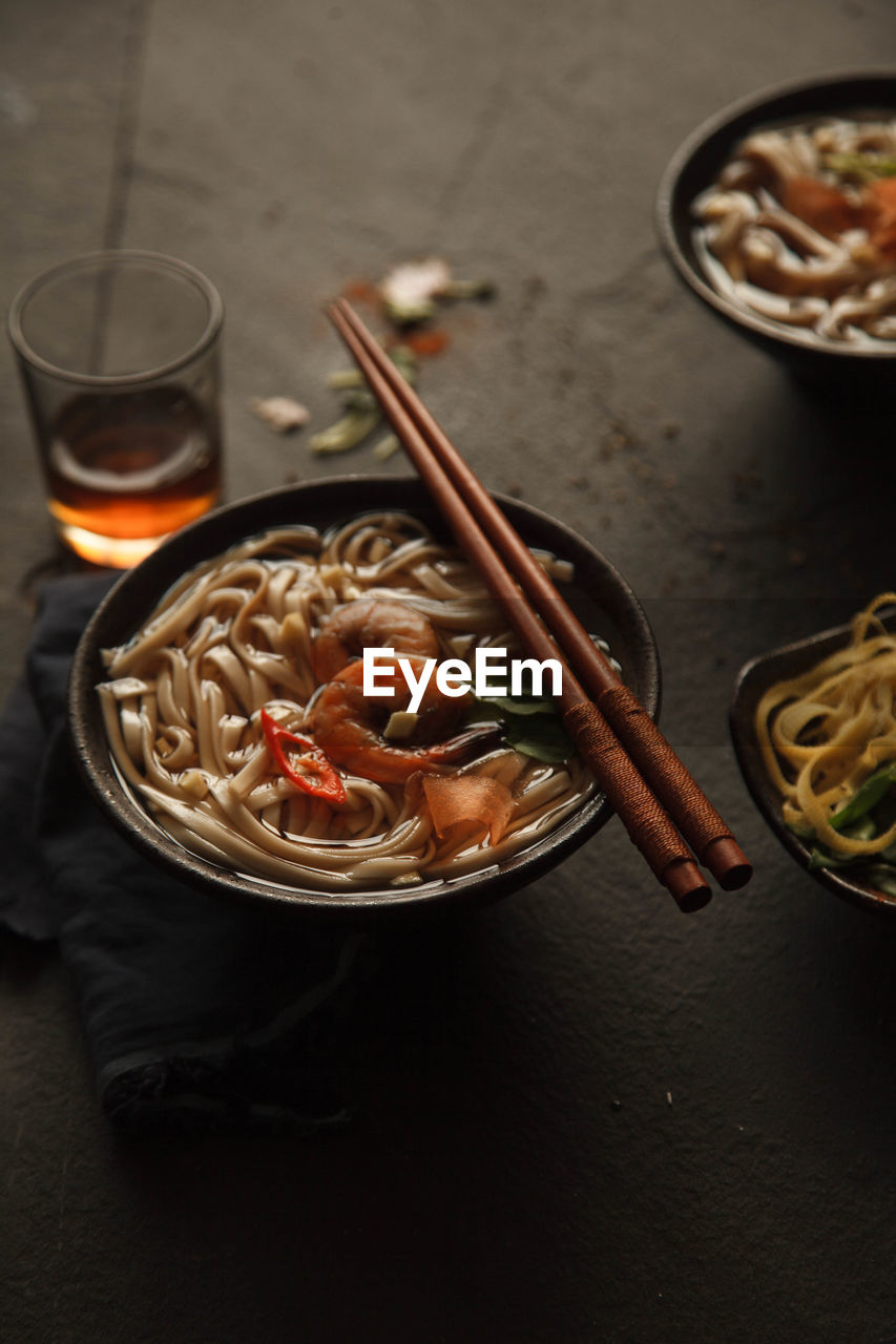 food and drink, food, pasta, freshness, table, chopsticks, italian food, ready-to-eat, no people, indoors, still life, healthy eating, wellbeing, seafood, bowl, drink, serving size, high angle view, asian food, close-up, meal, glass, spaghetti, japanese food, chinese food