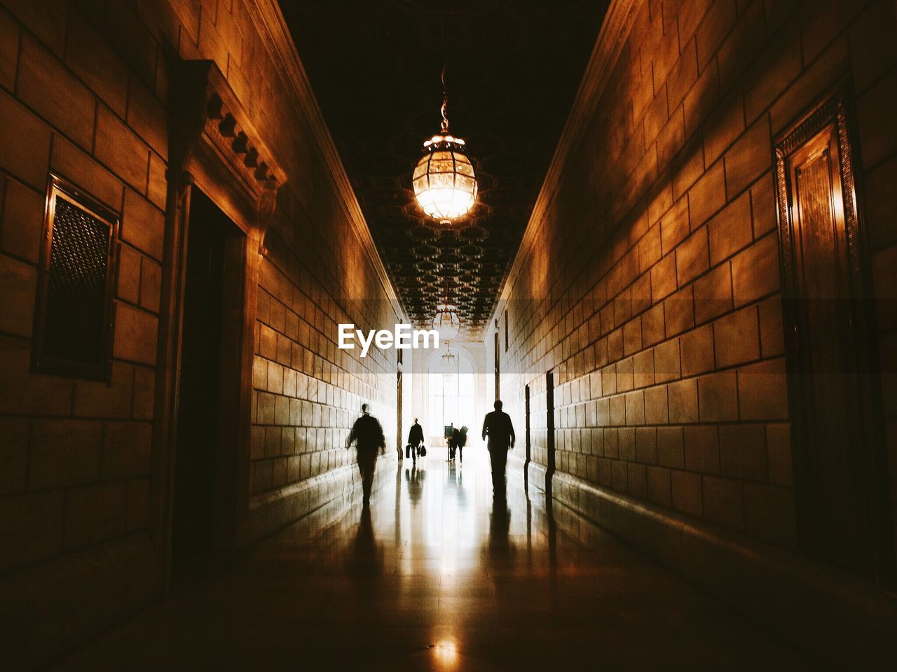 People in long corridor