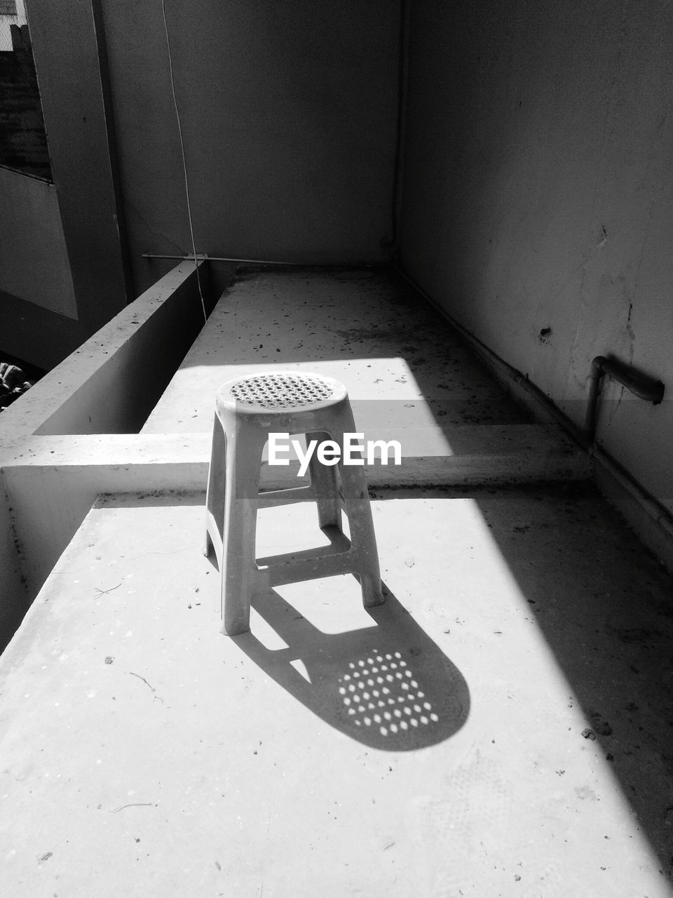 indoors, architecture, empty, no people, seat, high angle view, wall - building feature, chair, furniture, day, absence, abandoned, shadow, staircase, flooring, built structure, punishment, sunlight, steps and staircases, domestic room