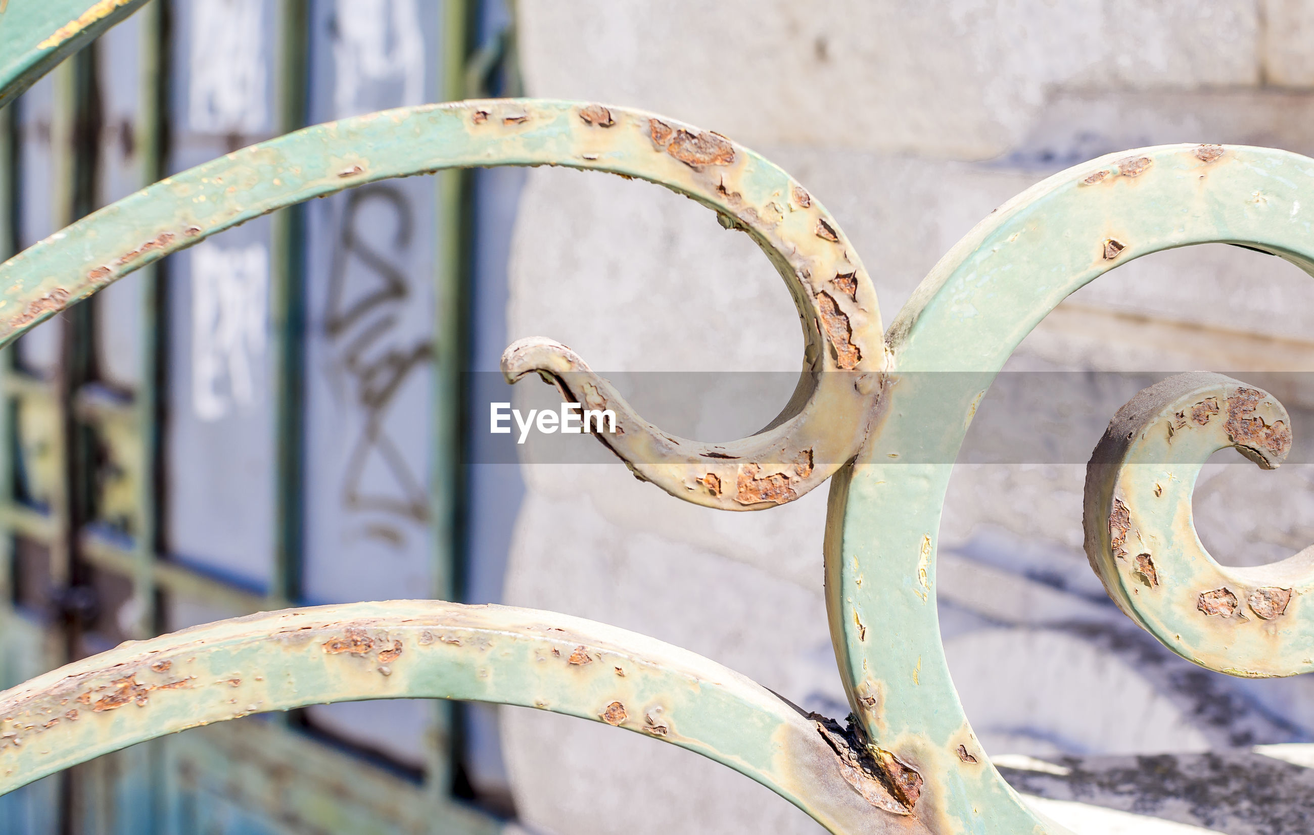 Close-up of rusty railing on sunny day