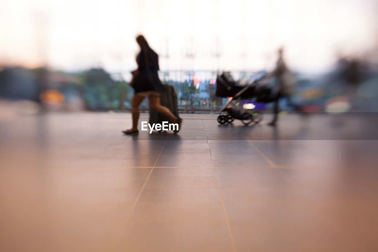 Blurred motion of people walking on floor