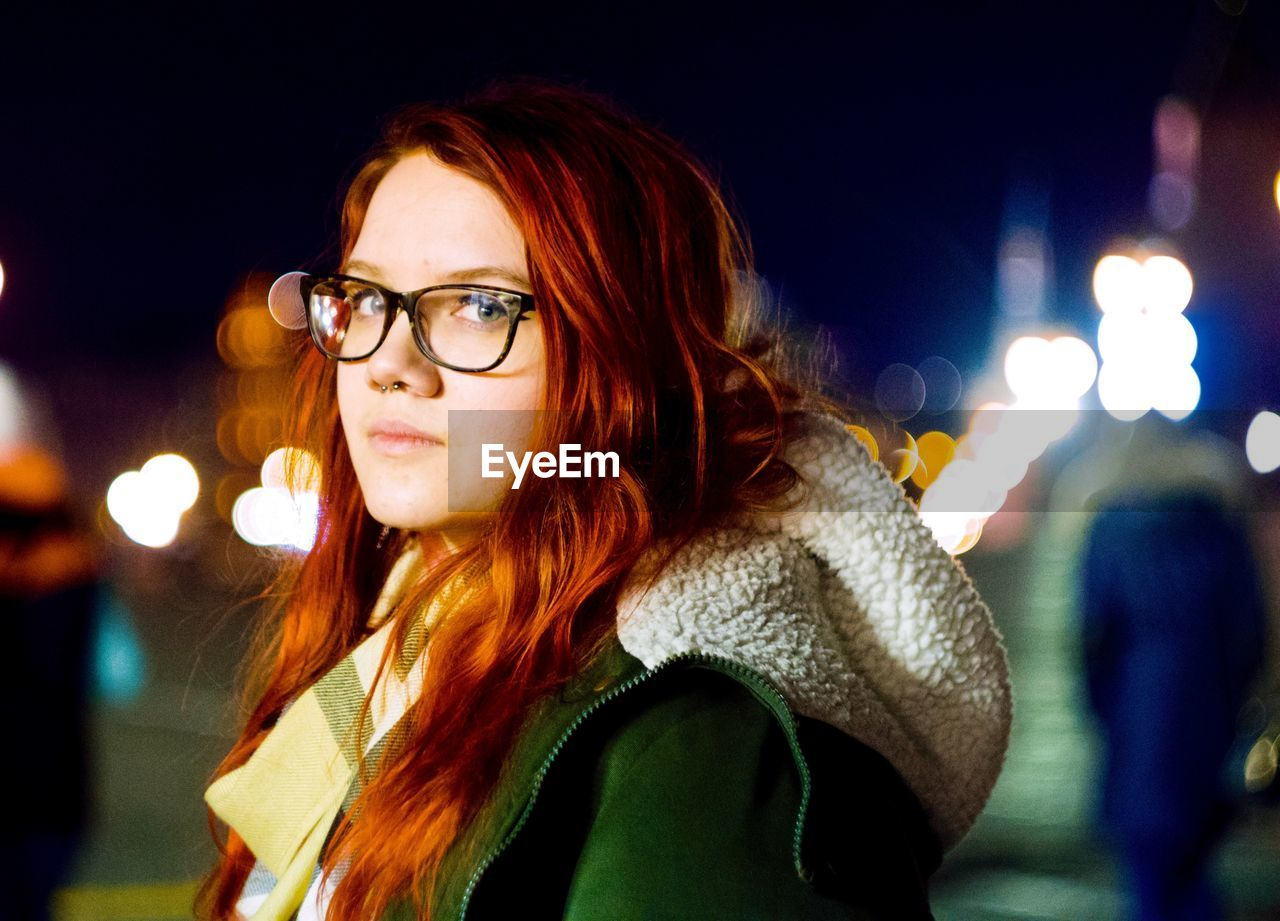 night, young adult, illuminated, portrait, lifestyles, one person, real people, young women, focus on foreground, leisure activity, headshot, eyeglasses, women, long hair, hairstyle, hair, glasses, looking, beautiful woman, scarf, outdoors, warm clothing, teenager