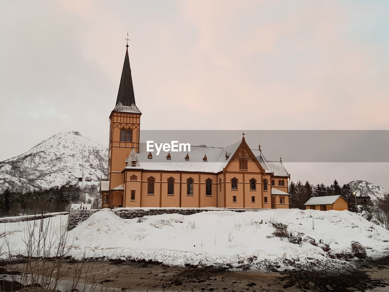 snow, cold temperature, winter, architecture, built structure, building exterior, building, sky, place of worship, nature, religion, belief, spirituality, no people, covering, tower, outdoors, snowcapped mountain, spire