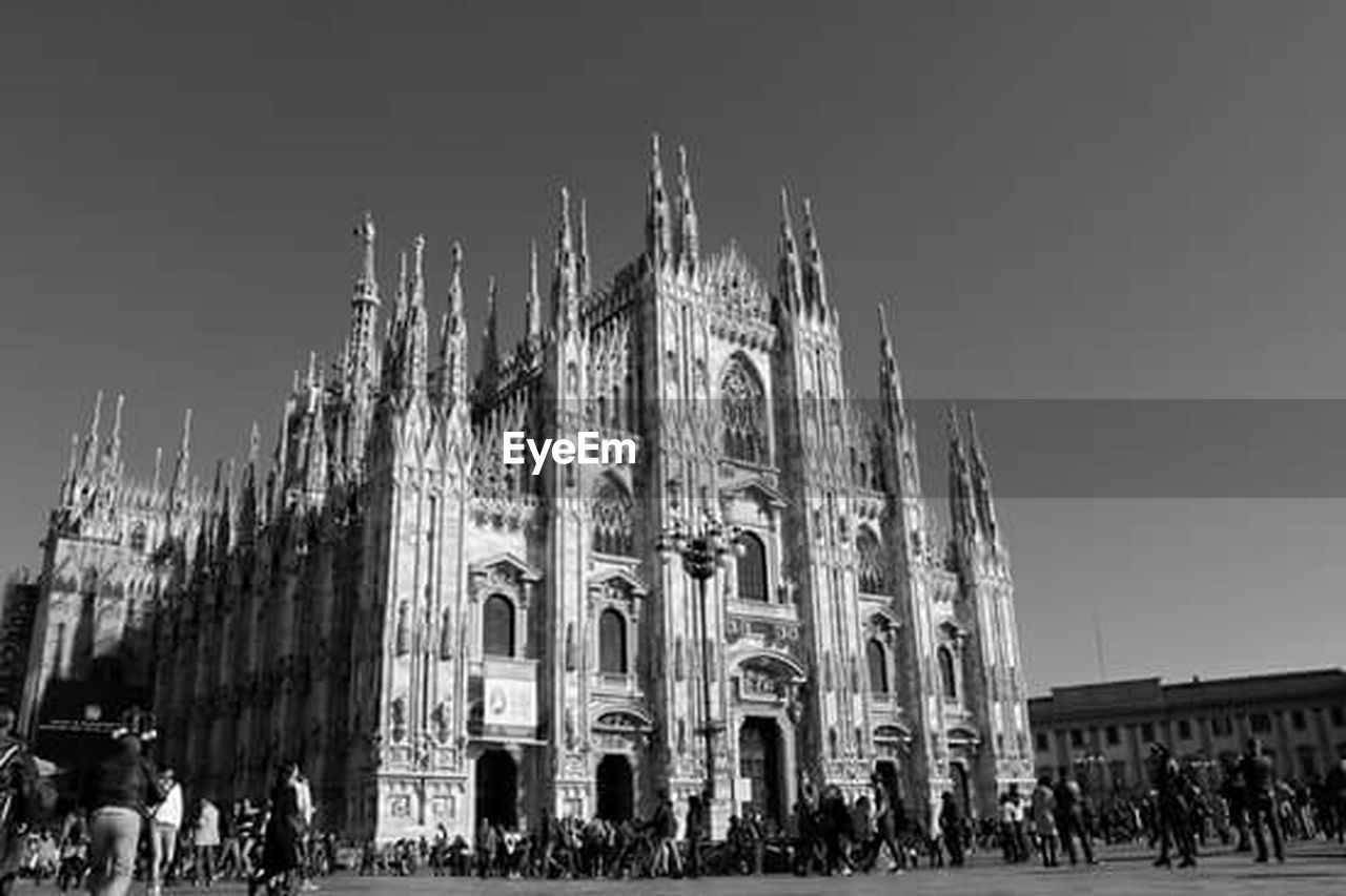 large group of people, architecture, building exterior, built structure, travel destinations, history, real people, clear sky, outdoors, people, sky, day, crowd, city, adults only, adult