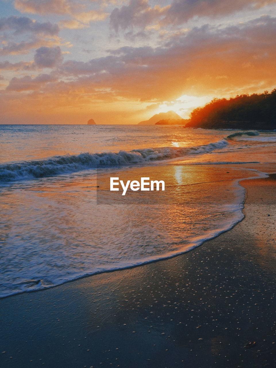 sky, water, sunset, sea, beach, land, beauty in nature, scenics - nature, cloud - sky, horizon over water, horizon, nature, tranquil scene, tranquility, wave, motion, orange color, idyllic, sport, no people, outdoors