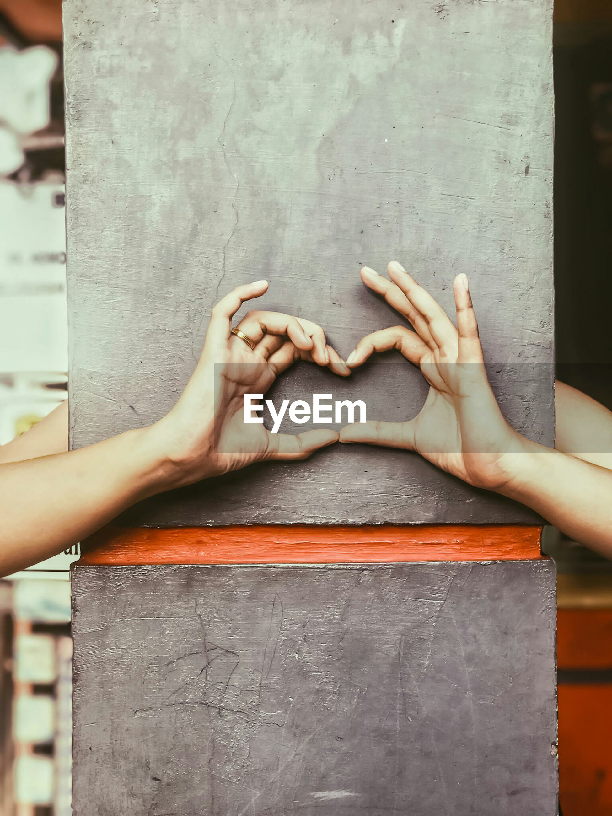 Close-up of hands making heart shape