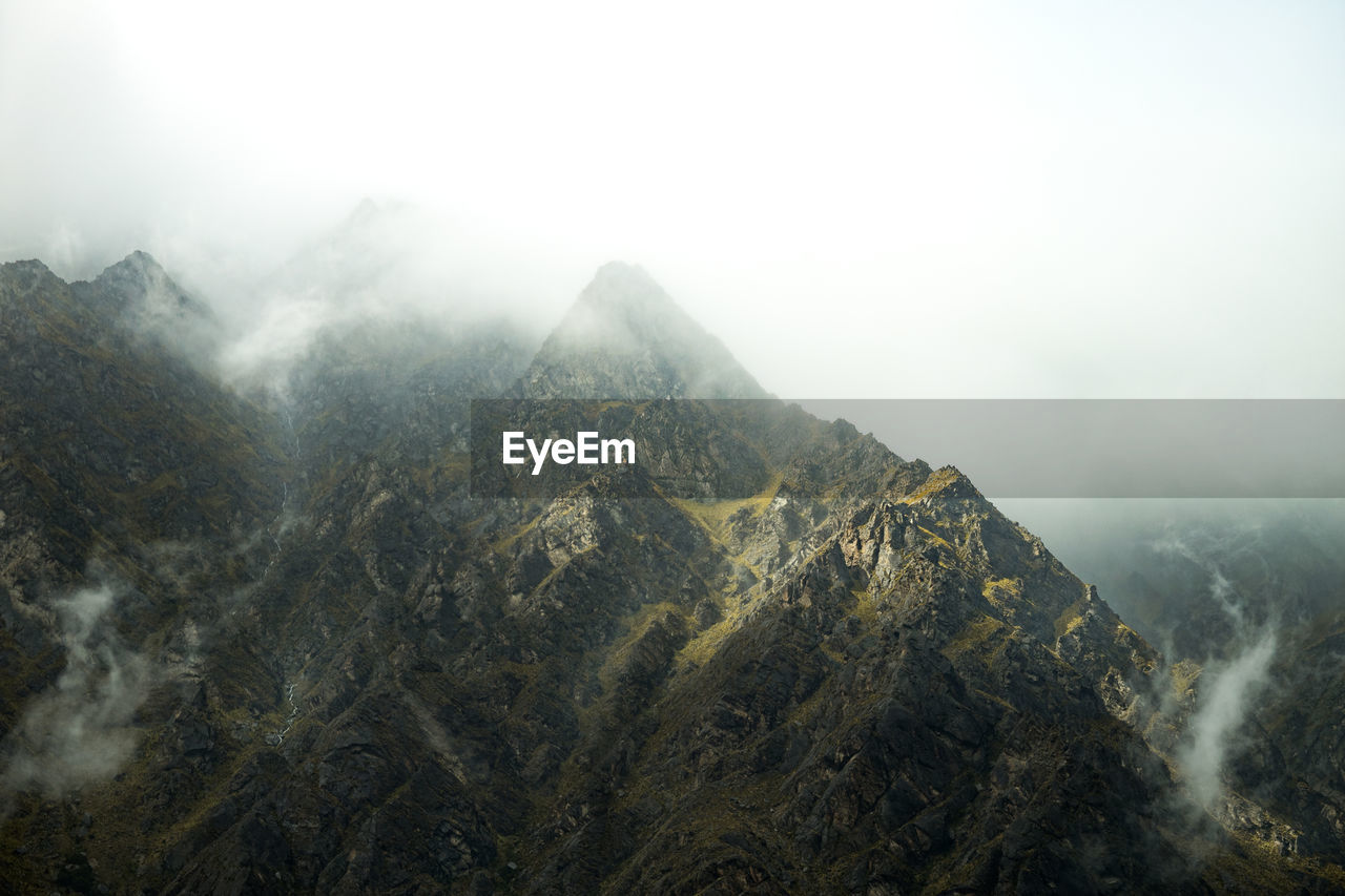 mountain, fog, beauty in nature, scenics - nature, tranquil scene, sky, tranquility, nature, non-urban scene, mountain range, no people, day, environment, mountain peak, landscape, outdoors, remote, idyllic, physical geography, formation