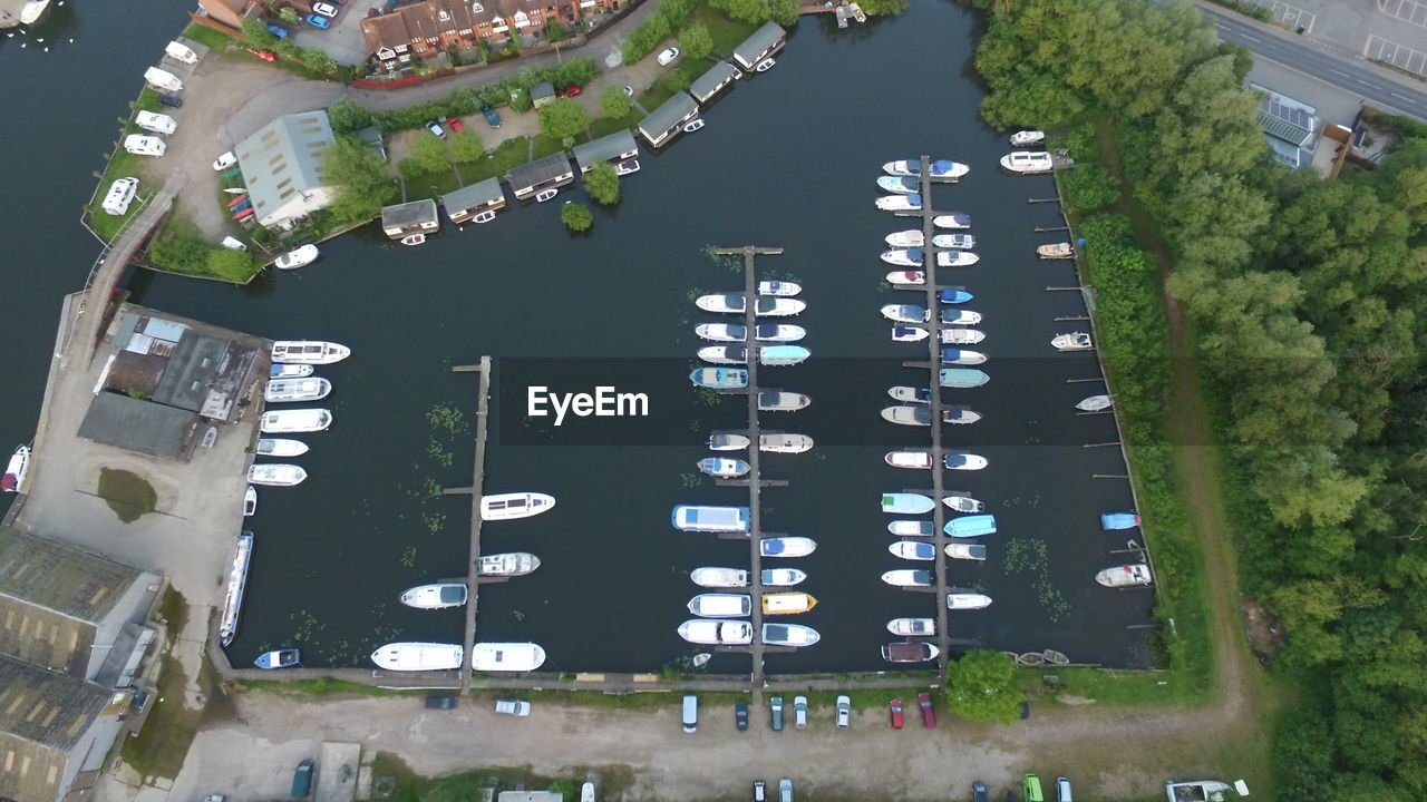 Aerial View Of Boats Moored At Harbor