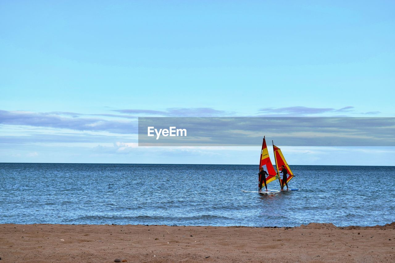 sea, horizon over water, sky, real people, day, sport, water, nature, scenics, outdoors, lifestyles, beach, cloud - sky, adventure, beauty in nature, one person, people