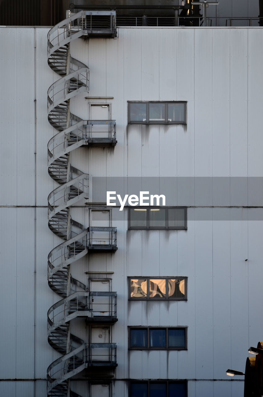 Low angle view of emergency stairs on building