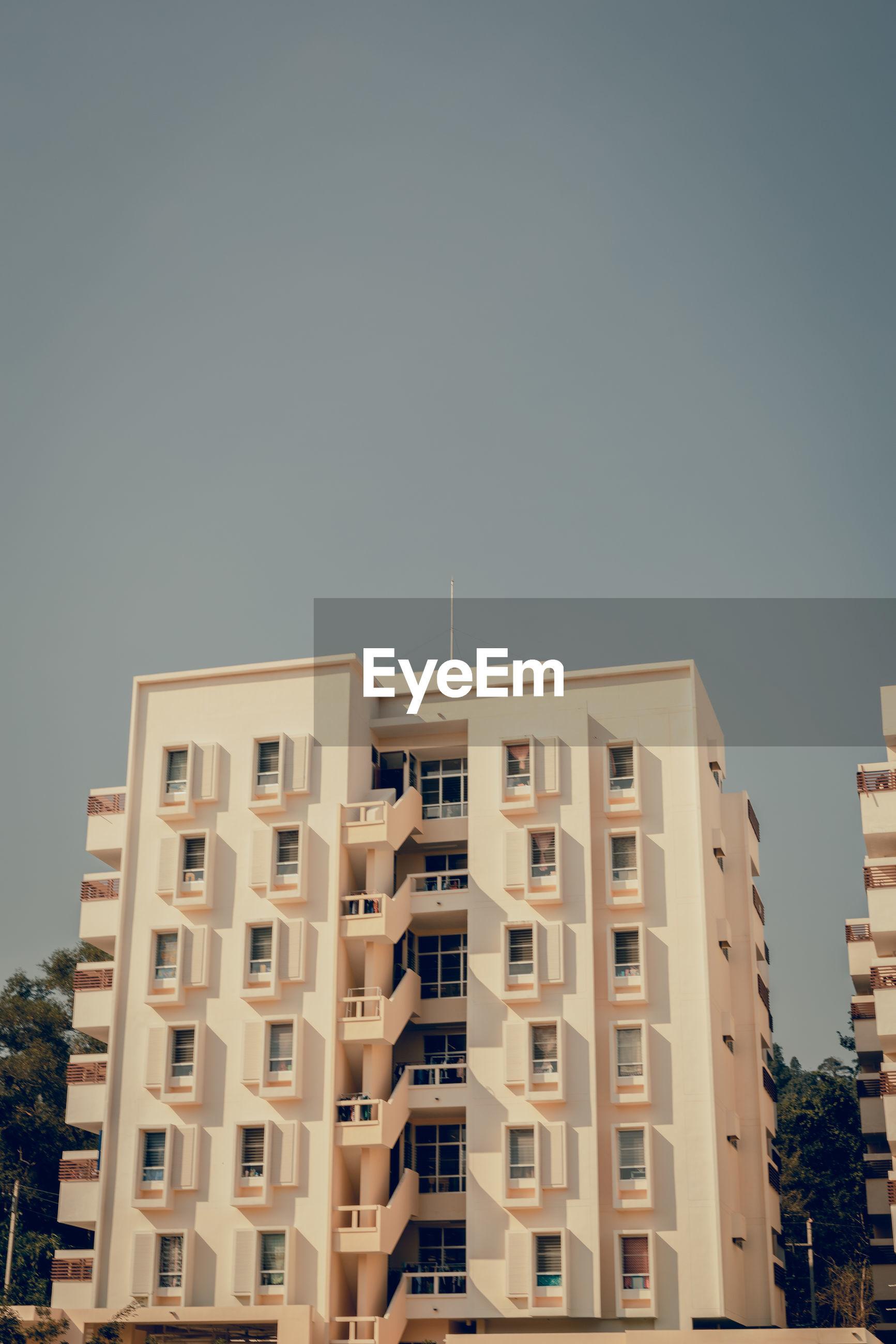 Exterior of apartment building against sky