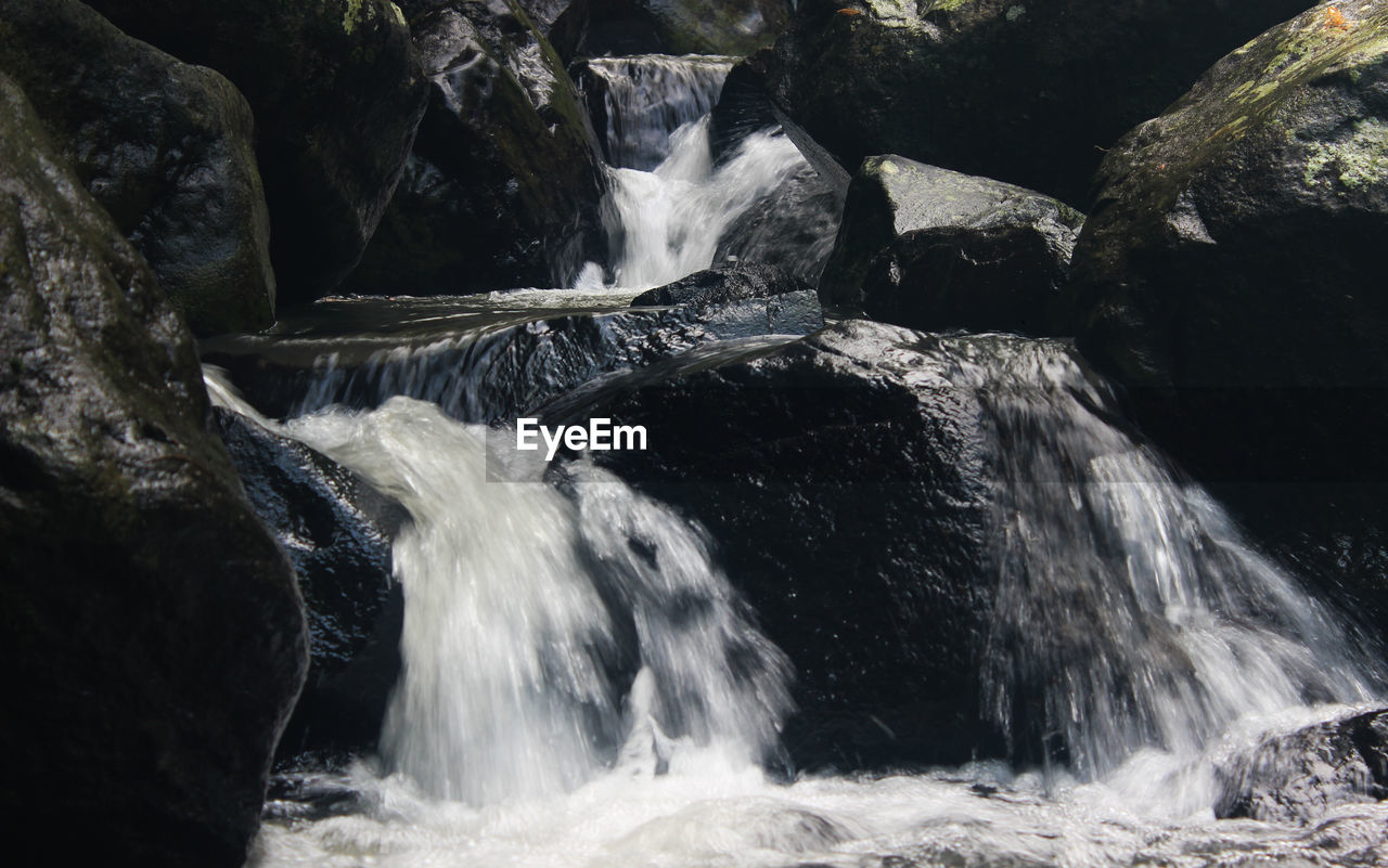 water, motion, long exposure, waterfall, rock, flowing water, beauty in nature, scenics - nature, nature, blurred motion, rock - object, no people, solid, sea, sport, flowing, environment, land, rock formation, outdoors, power in nature, running water, falling water, purity