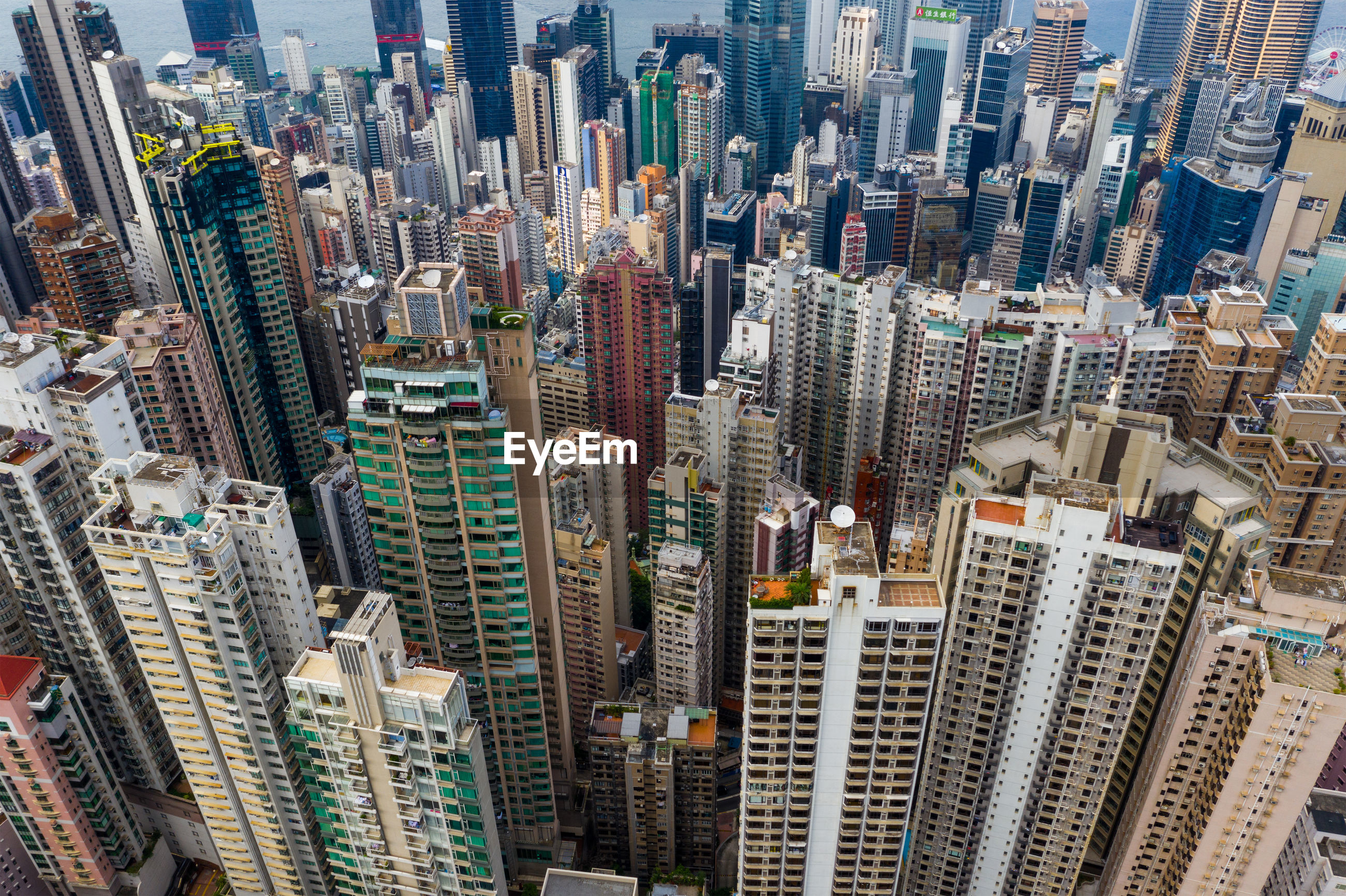 HIGH ANGLE VIEW OF MODERN BUILDINGS IN CITY AT SKYSCRAPERS