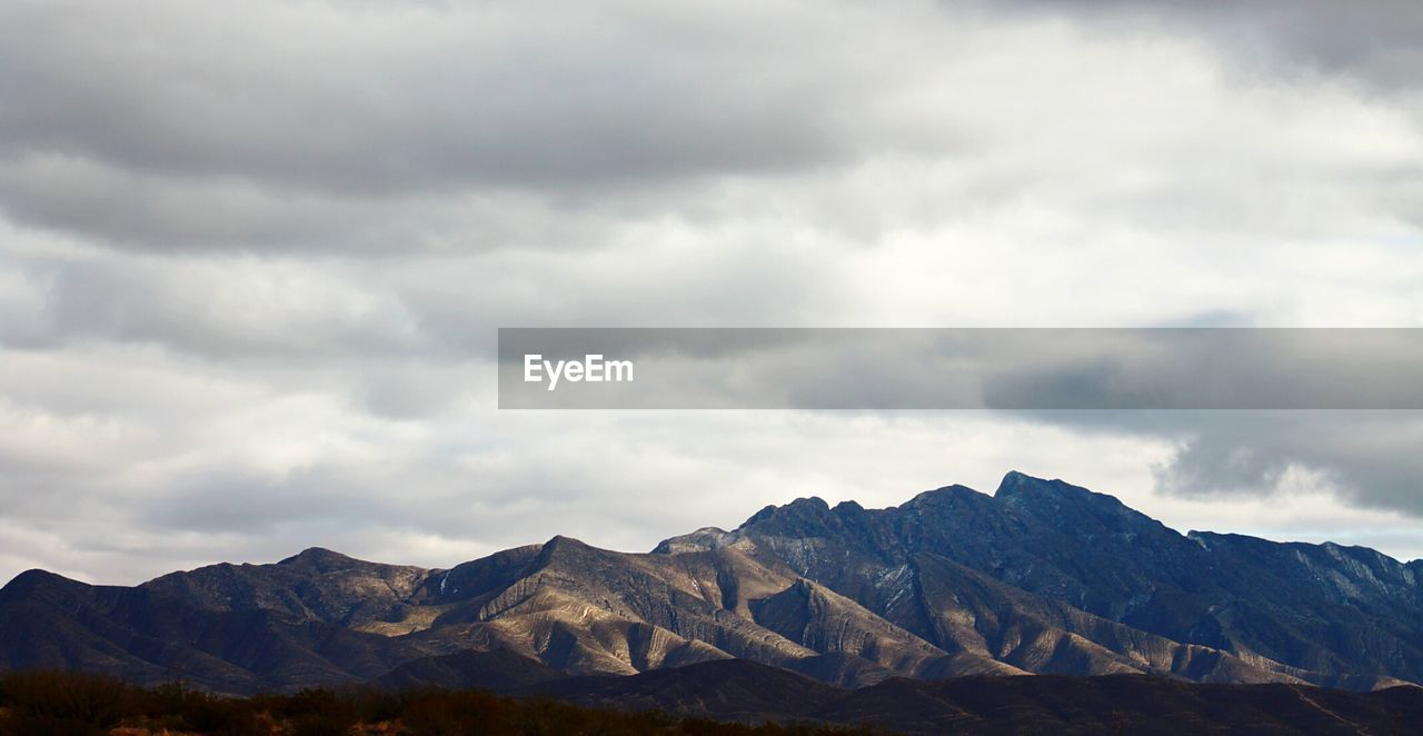 View Of Franklin Mountains Against Cloudy Sky