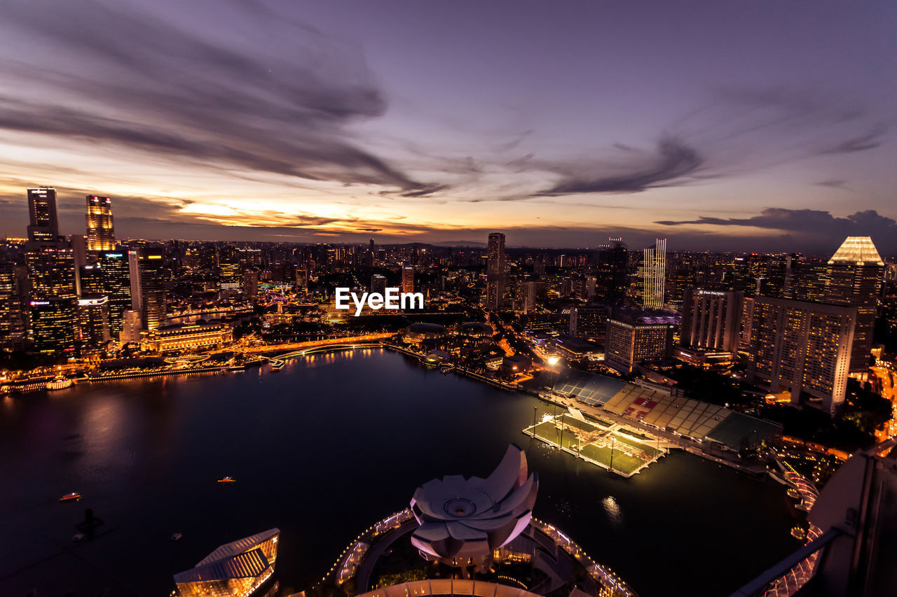 architecture, building exterior, city, built structure, sky, cityscape, cloud - sky, water, illuminated, building, nature, no people, high angle view, night, river, sunset, office building exterior, skyscraper, outdoors, modern, bay