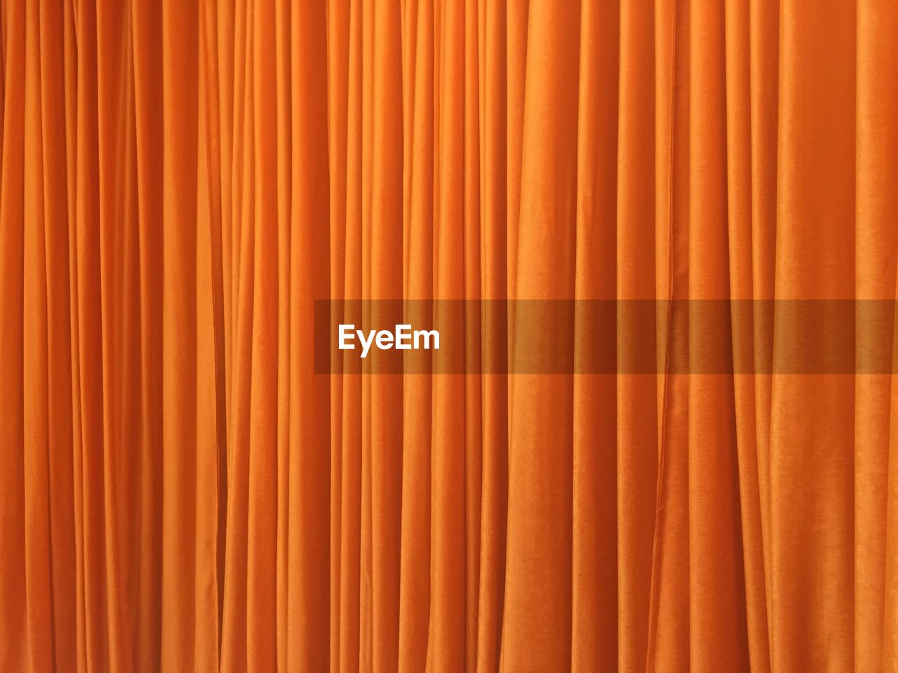Full Frame Shot Of Orange Curtain