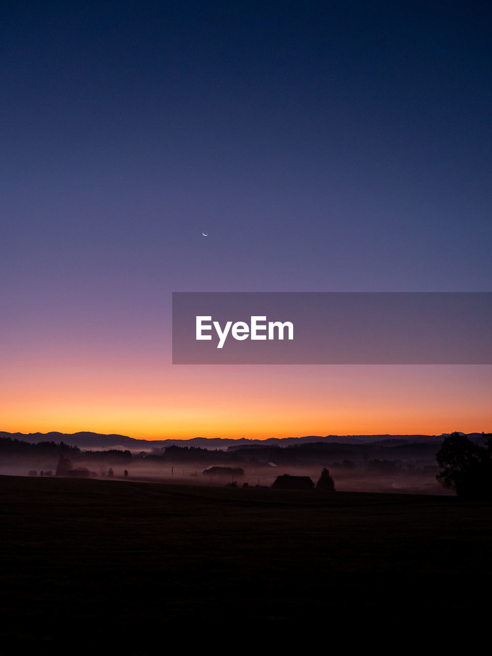 sky, scenics - nature, landscape, environment, sunset, beauty in nature, tranquil scene, tranquility, silhouette, copy space, nature, no people, idyllic, clear sky, moon, non-urban scene, dusk, land, orange color, blue, outdoors