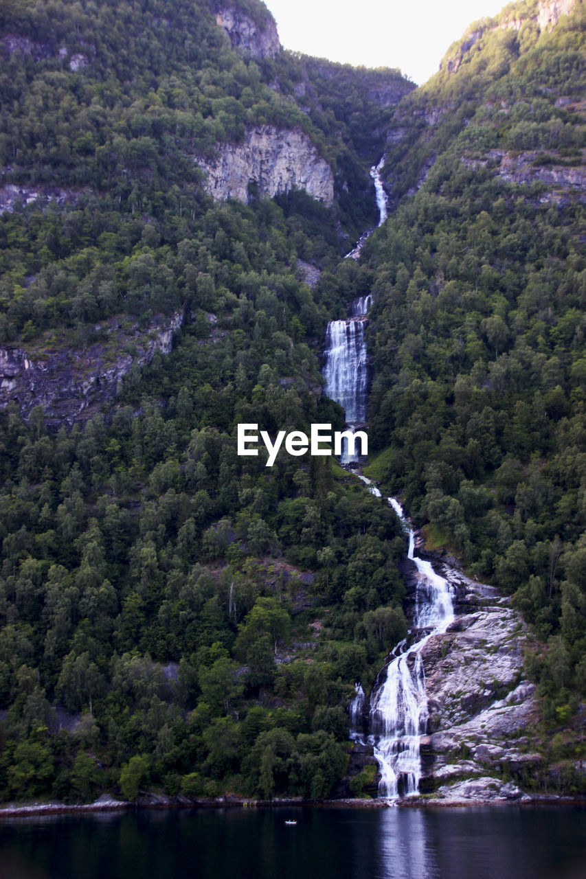 water, tree, beauty in nature, scenics - nature, waterfall, mountain, nature, plant, motion, day, flowing water, forest, no people, rock, growth, land, environment, long exposure, tranquility, outdoors, flowing, power in nature, formation