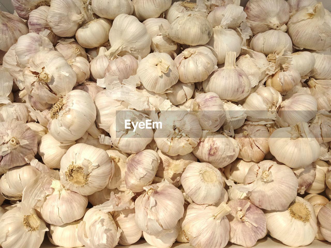 Full frame shot of garlic for sale in market