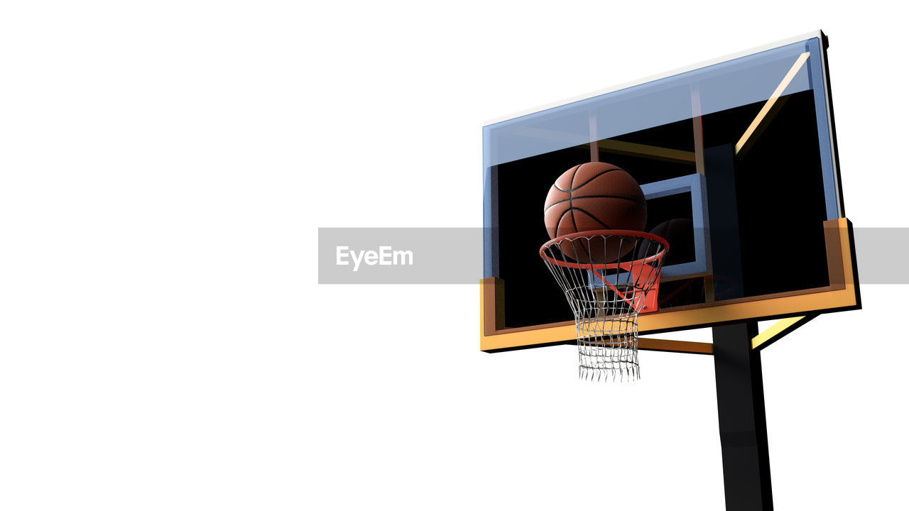 Low Angle View Of Basketball Hoop Against White Background