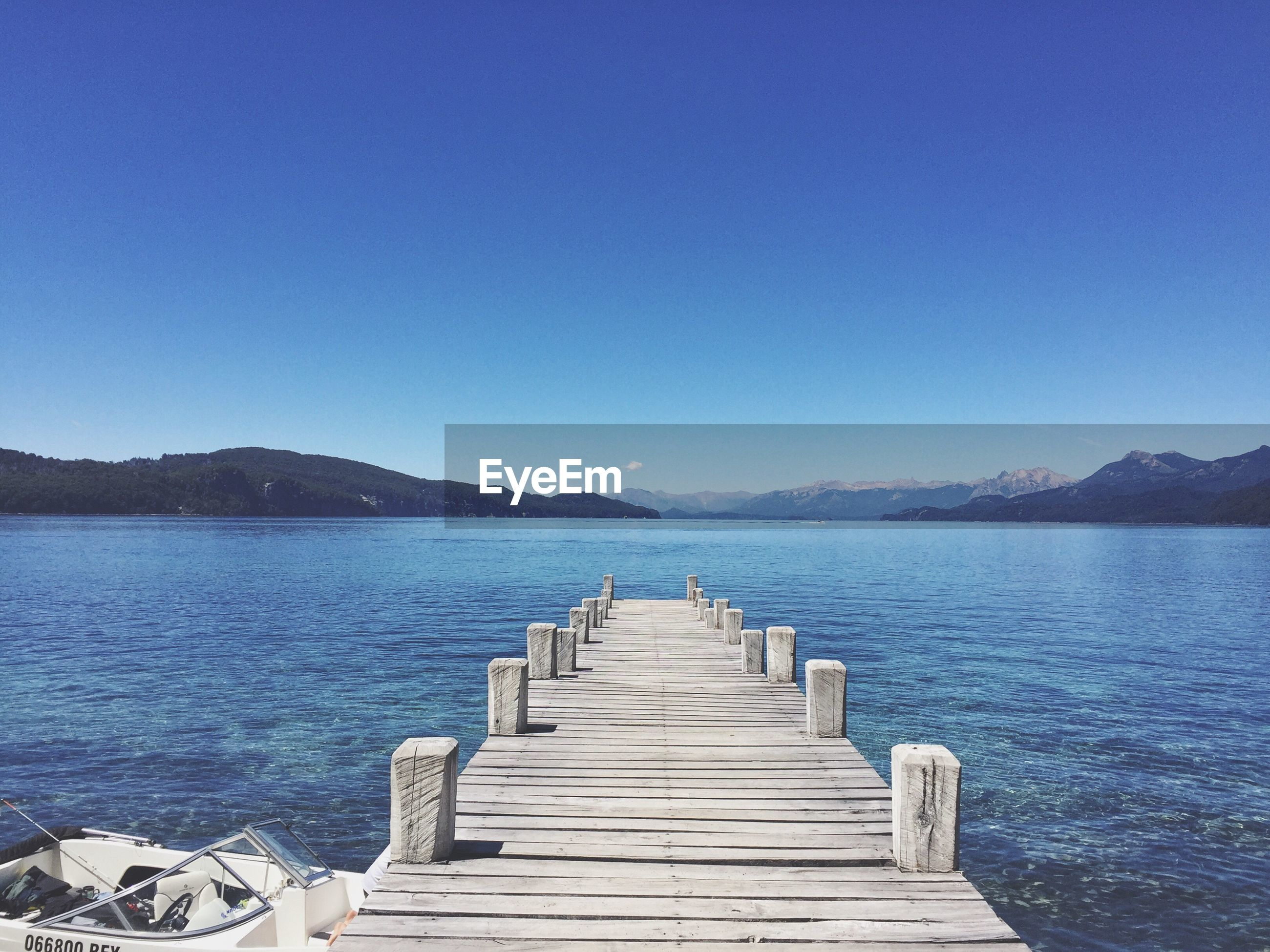 clear sky, blue, water, pier, tranquil scene, no people, sky, nature, beauty in nature, sea, tranquility, scenics, outdoors, day
