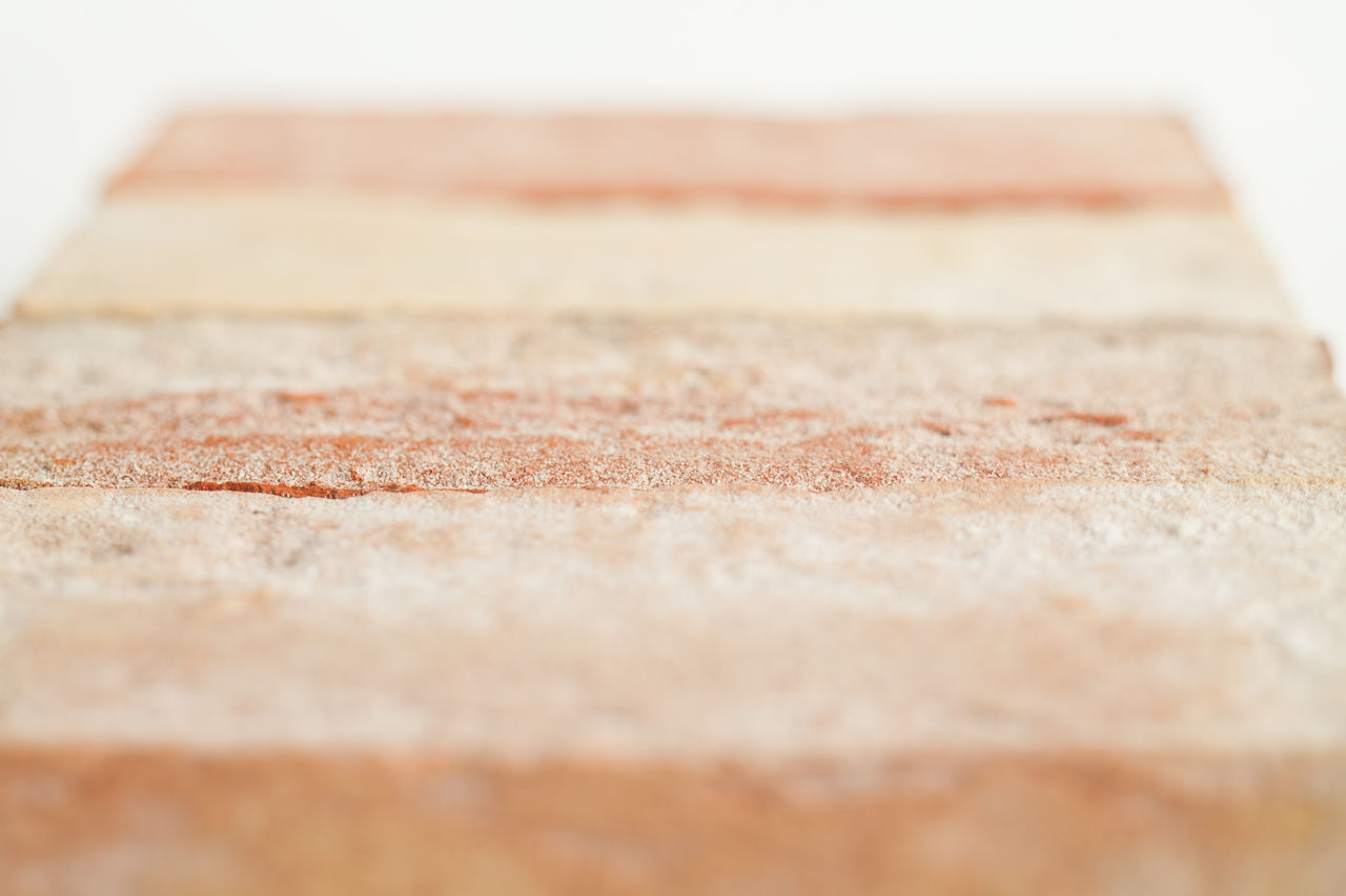 selective focus, close-up, no people, still life, textured, indoors, brown, pattern, wood - material, studio shot, beige, shape, day, copy space, in a row, geometric shape, table, surface level, focus on foreground