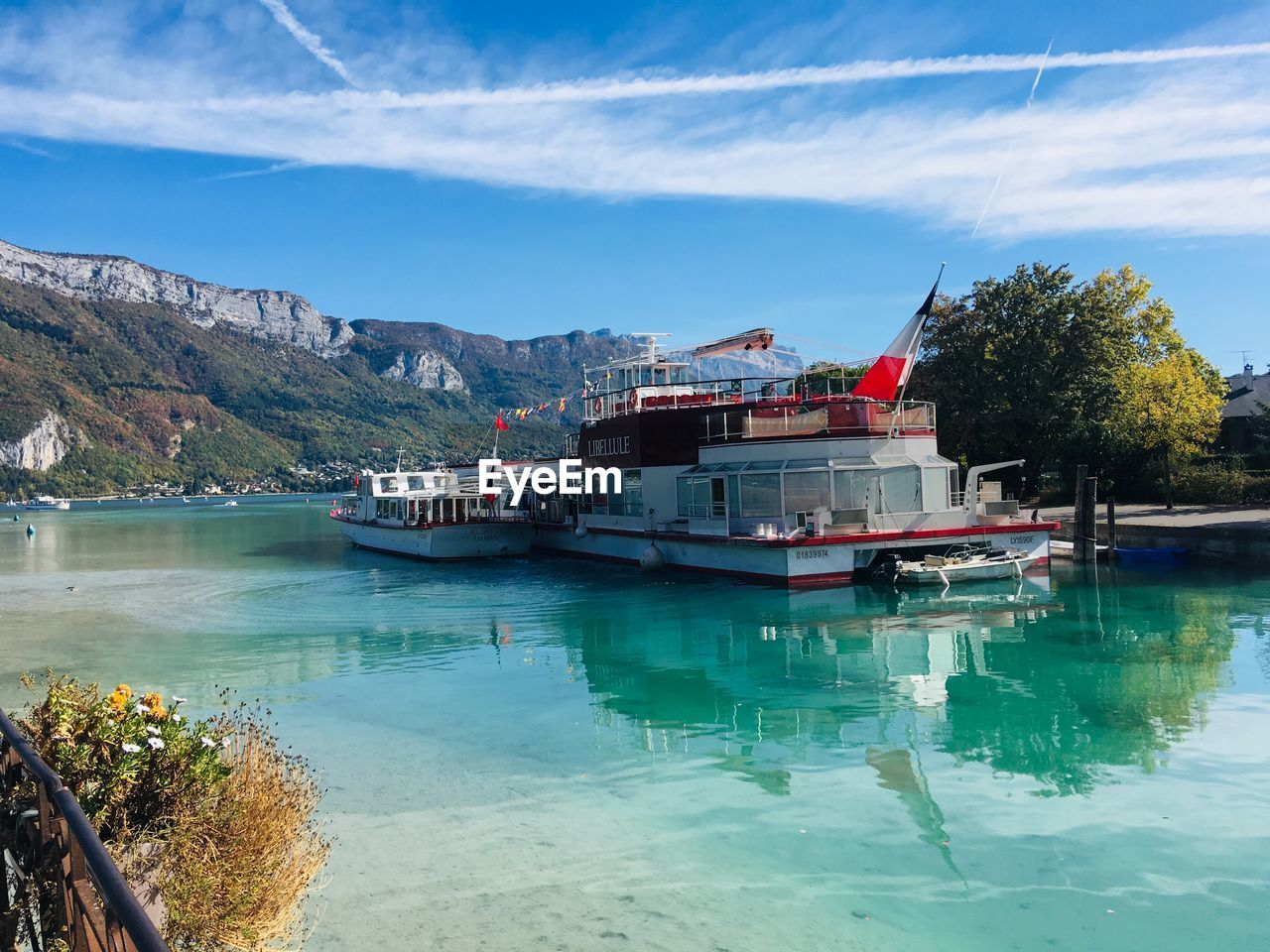 water, nautical vessel, mode of transportation, sky, transportation, cloud - sky, nature, mountain, day, no people, ship, reflection, waterfront, beauty in nature, moored, sea, outdoors, architecture, plant, passenger craft, cruise ship