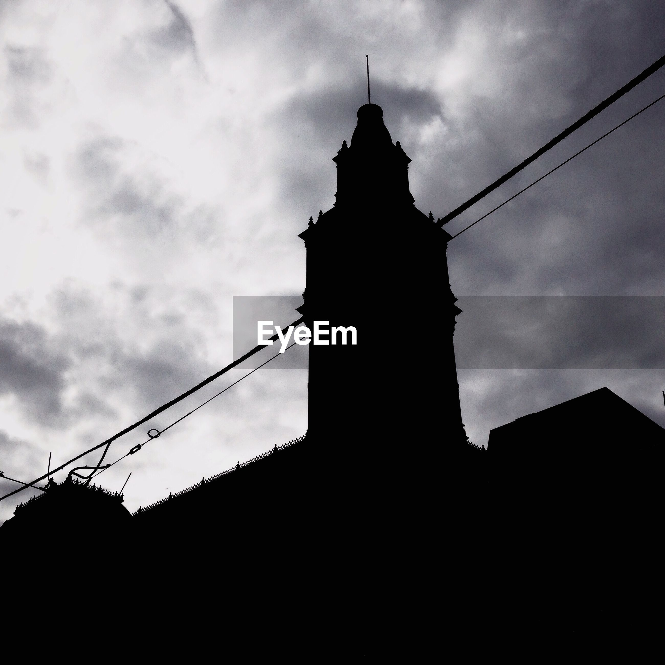 architecture, built structure, sky, low angle view, building exterior, silhouette, cloud - sky, cloudy, cloud, connection, sunset, dusk, no people, outdoors, cable, history, power line, tower, church, travel destinations