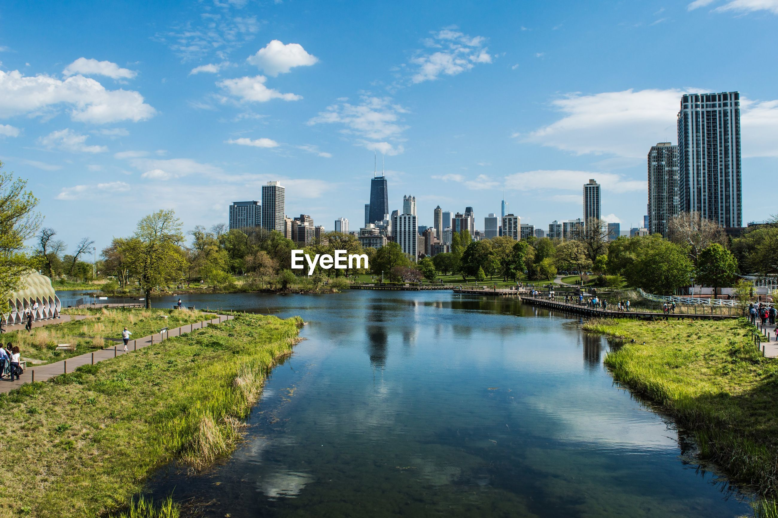 SCENIC VIEW OF RIVER AND CITY AGAINST SKY