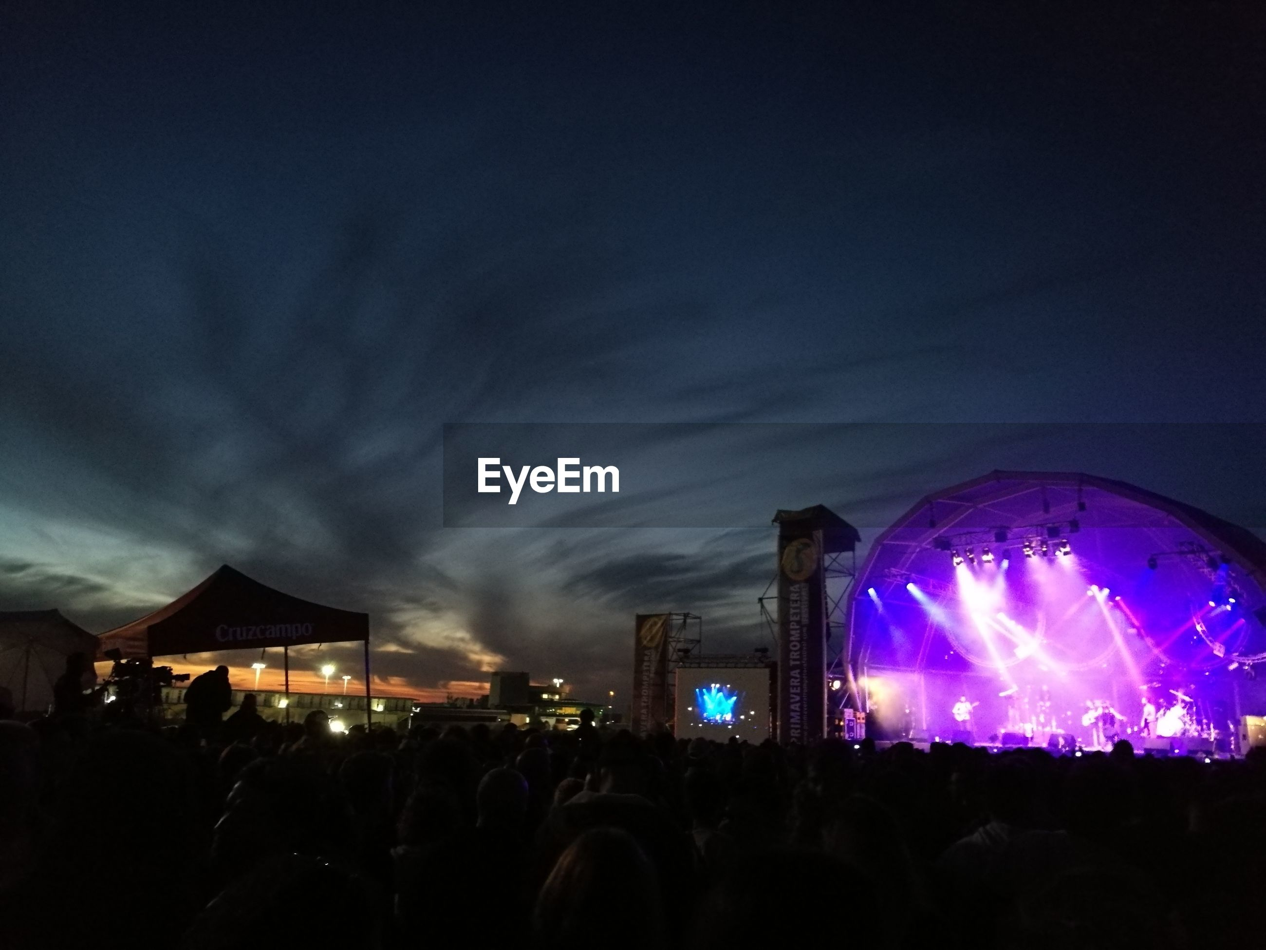 night, illuminated, sky, city, popular music concert, event, architecture, nightlife, outdoors, people, crowd, star - space