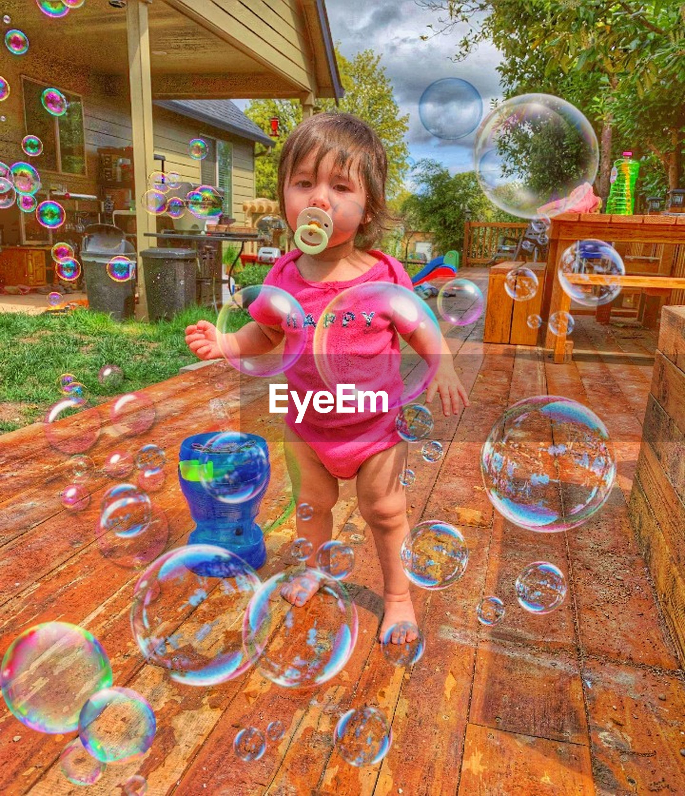 childhood, child, one person, full length, happiness, playing, enjoyment, smiling, fun, emotion, cheerful, bubble, innocence, multi colored, offspring, standing, day, portrait, casual clothing, outdoors