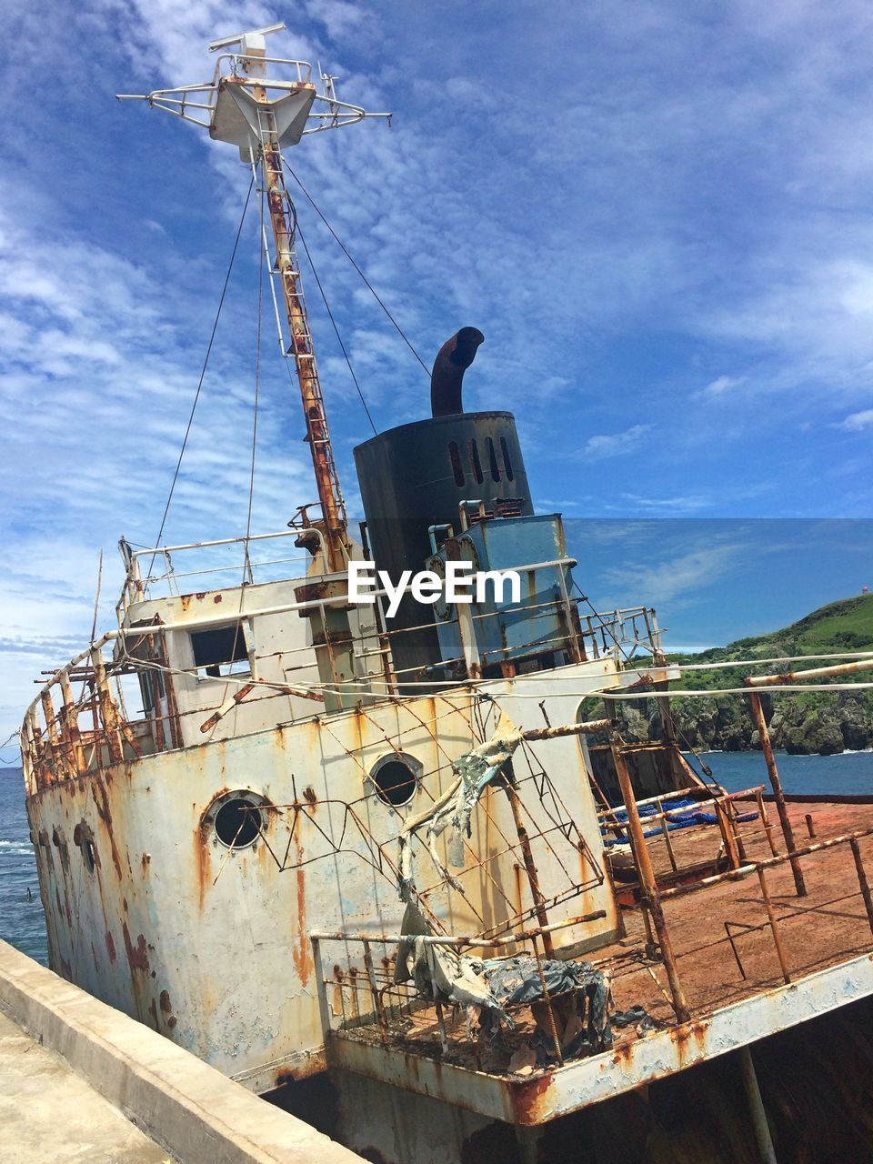 nautical vessel, sky, transportation, ship, mode of transport, sea, damaged, moored, cloud - sky, outdoors, abandoned, day, rusty, no people, low angle view, nature, mast, shipyard, sailing ship, oil pump
