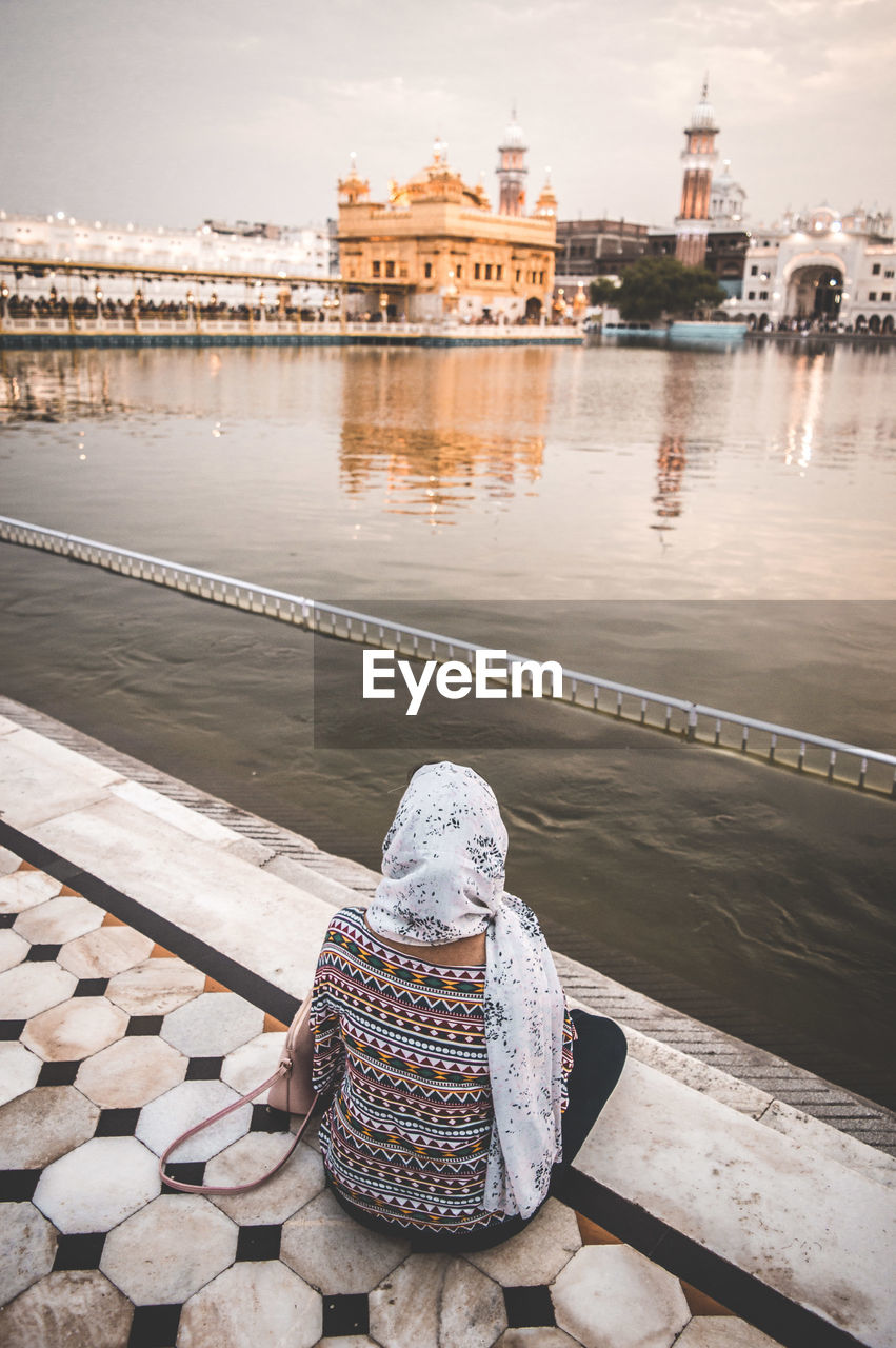 View of golden temple from a girl