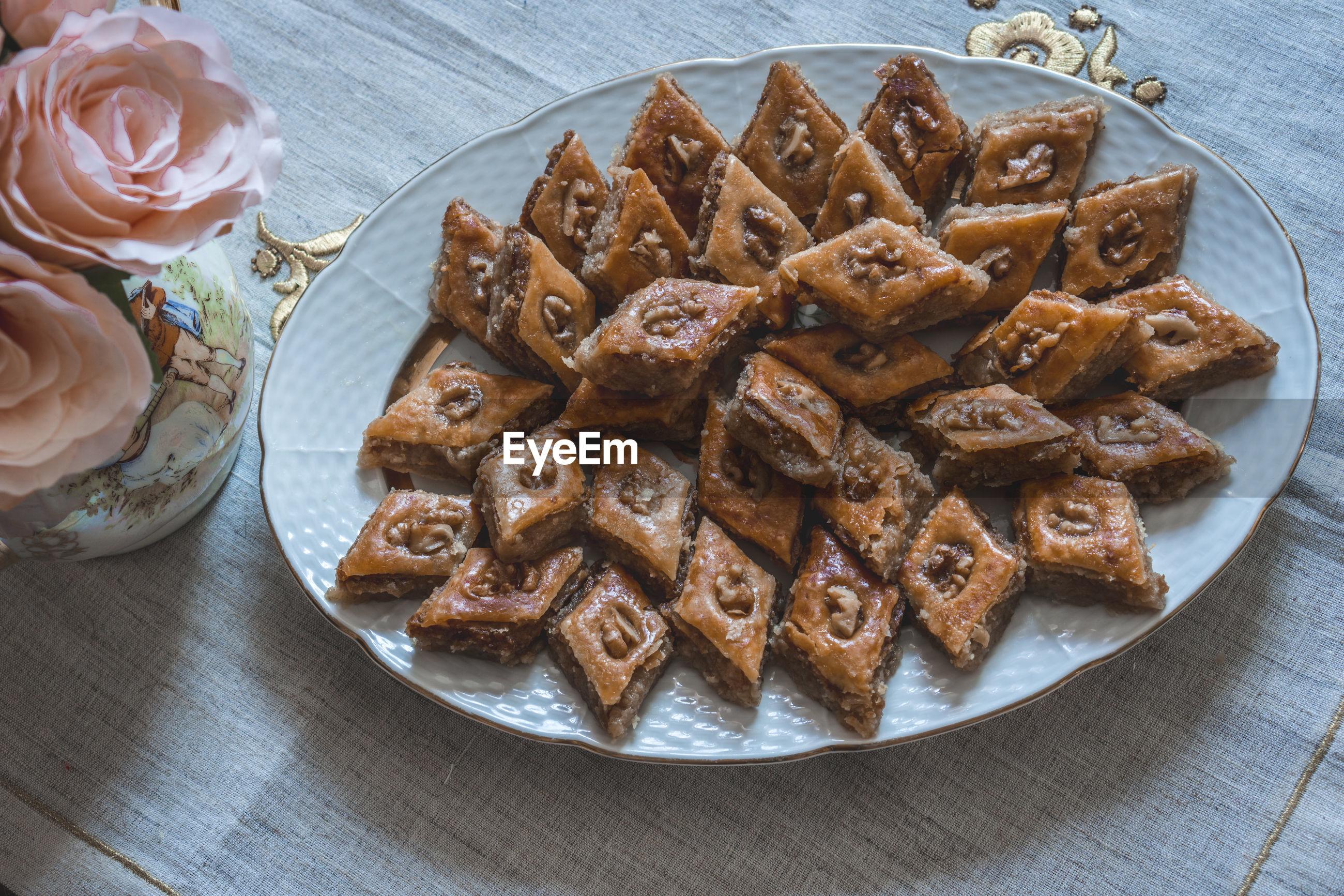 Traditional azerbaijan holiday nowruz cookies baklava on white plate.