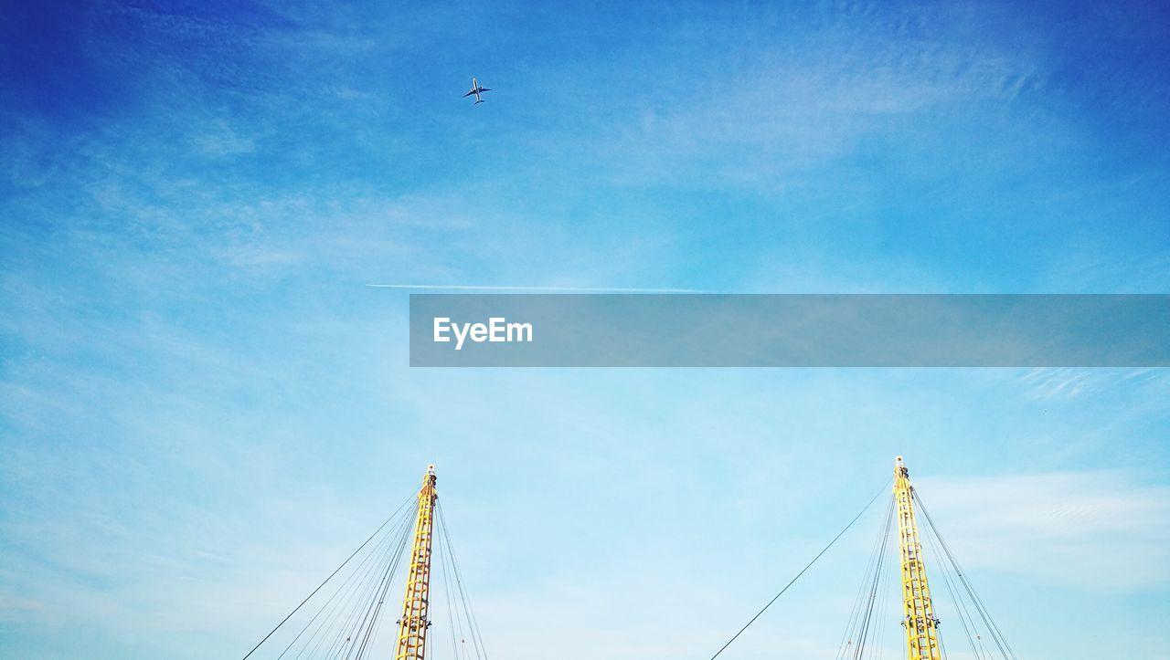 Cropped image of metallic bridge against sky