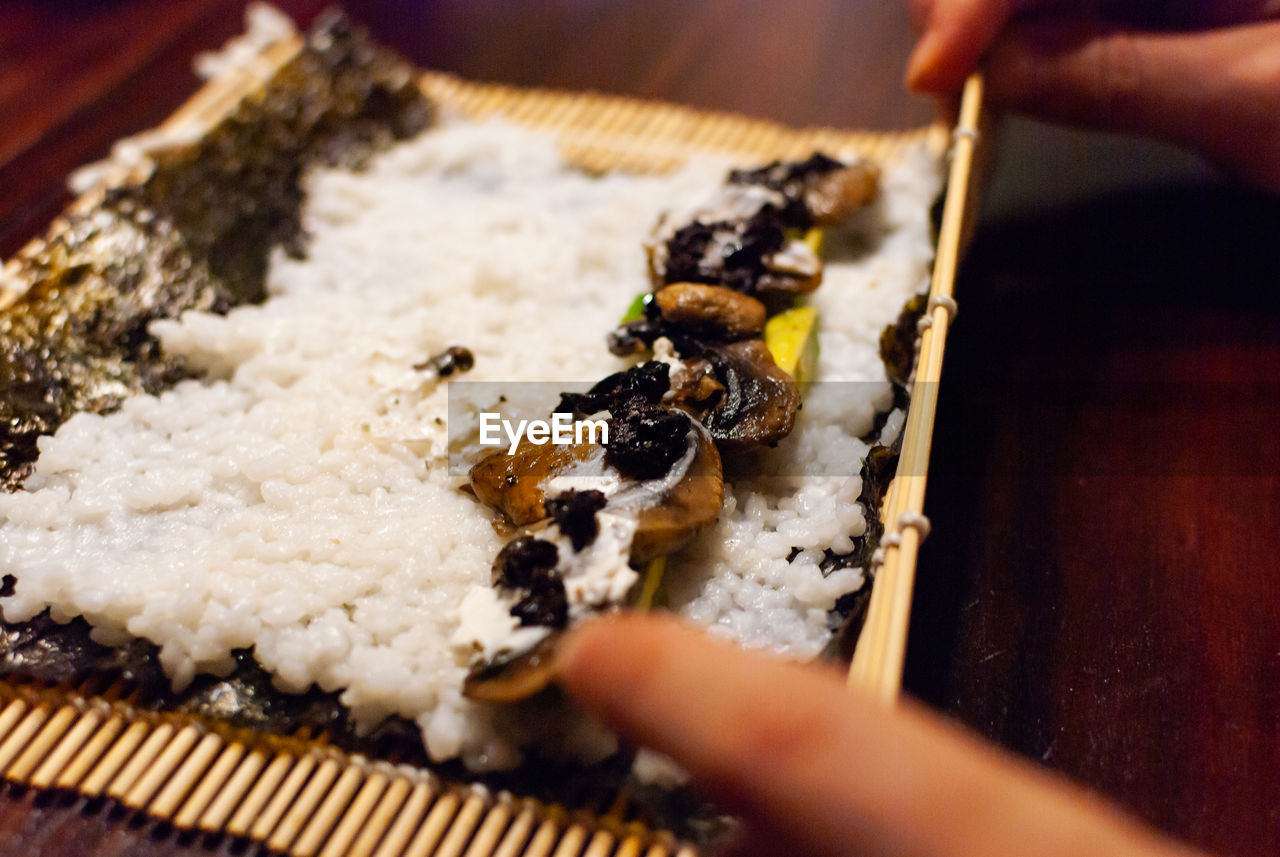 human hand, hand, human body part, food, food and drink, real people, one person, unrecognizable person, selective focus, finger, human finger, freshness, holding, indoors, body part, lifestyles, preparation, close-up, ready-to-eat, japanese food, preparing food, temptation