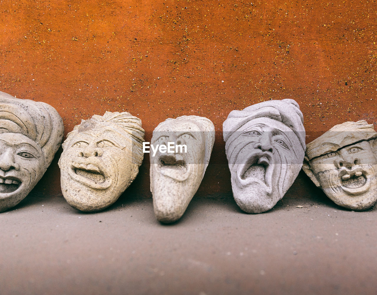 Close-up of human face carved on clay