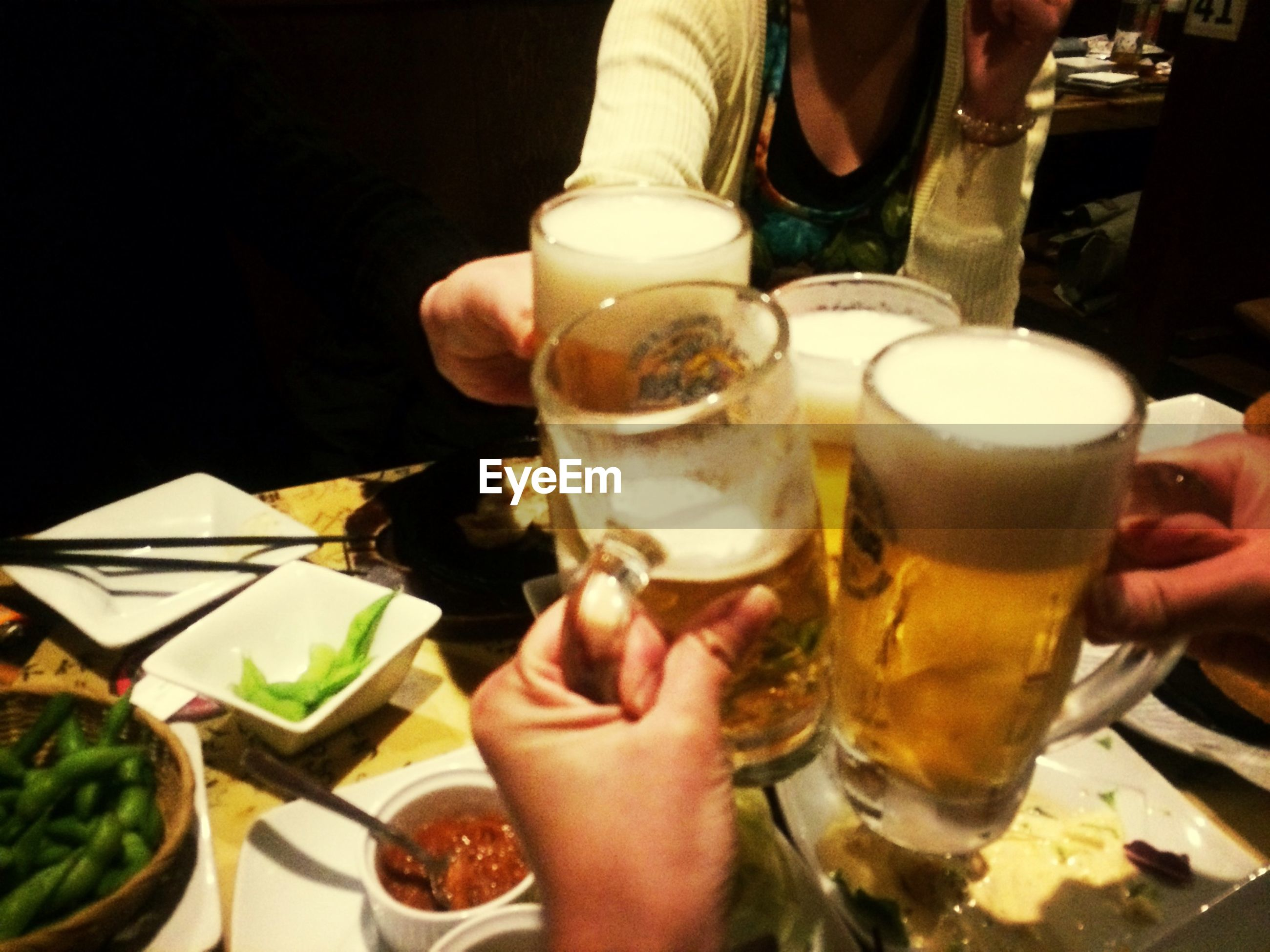food and drink, person, drink, freshness, holding, refreshment, food, lifestyles, part of, drinking glass, indoors, table, cropped, men, unrecognizable person, leisure activity