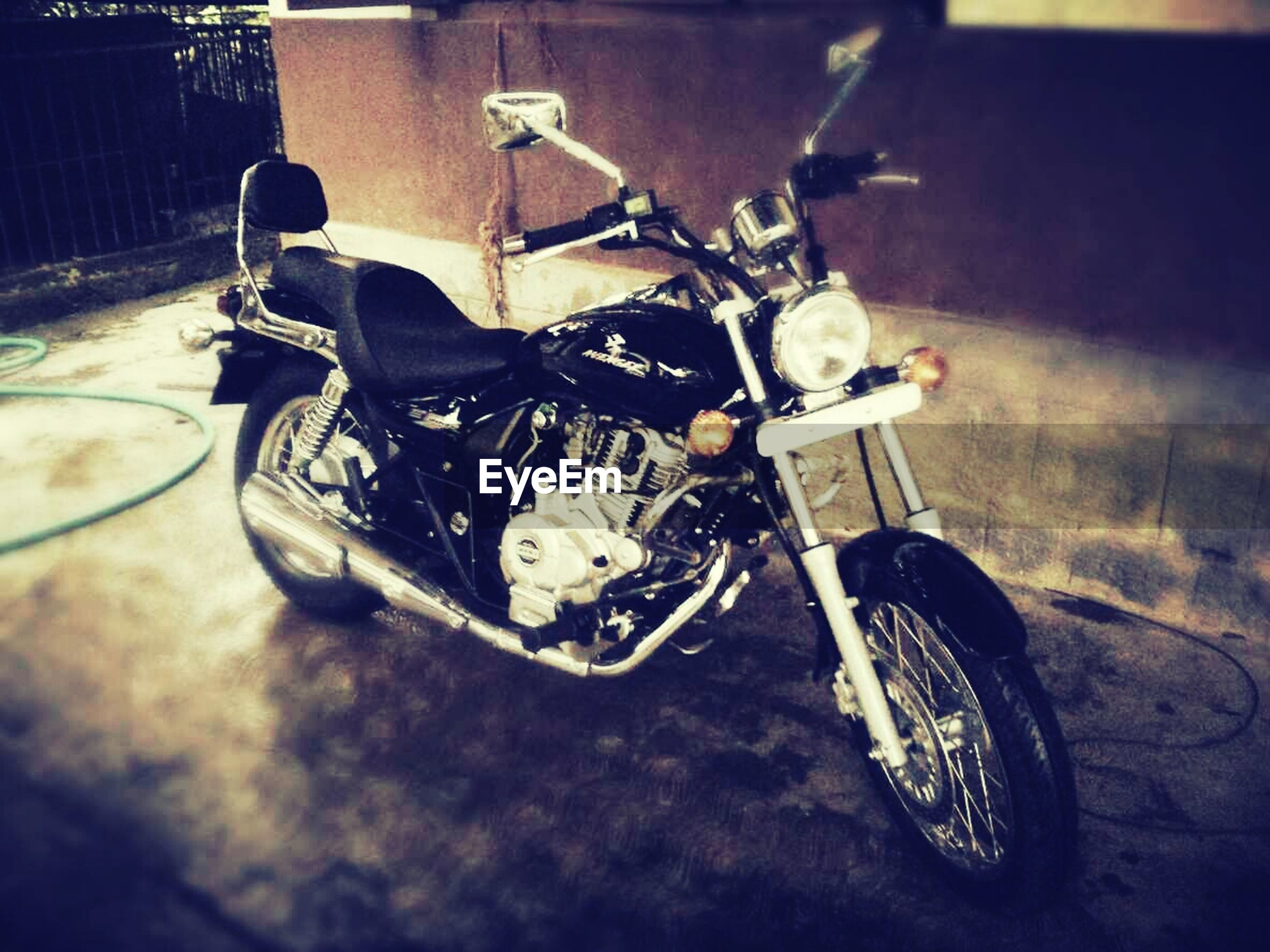 bicycle, land vehicle, transportation, mode of transport, stationary, parked, parking, motorcycle, street, wheel, day, car, high angle view, cycle, motor scooter, no people, old-fashioned, travel, outdoors, still life