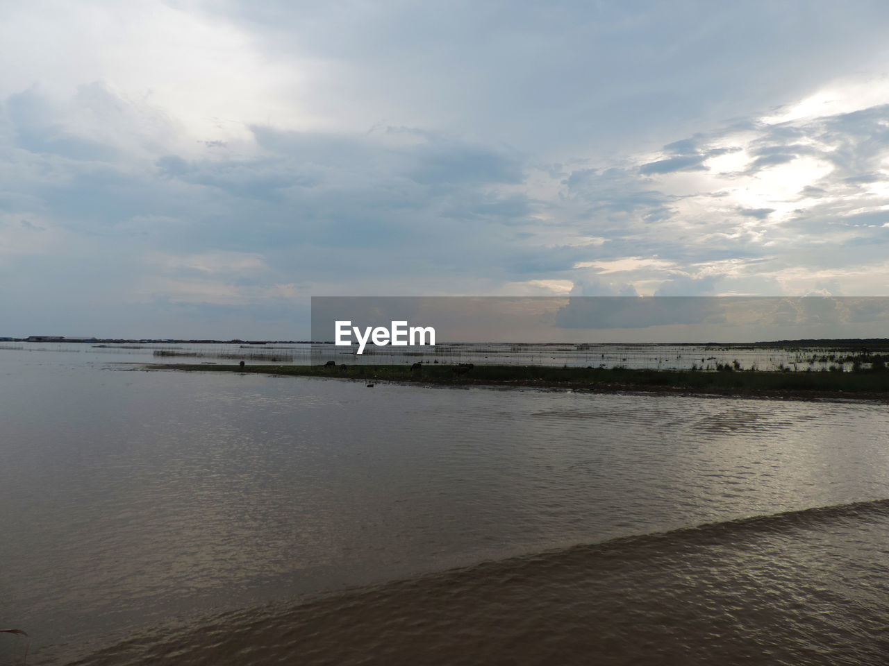 water, sky, cloud - sky, scenics - nature, beauty in nature, sea, tranquility, tranquil scene, land, beach, horizon, nature, horizon over water, non-urban scene, idyllic, no people, sand, outdoors, day