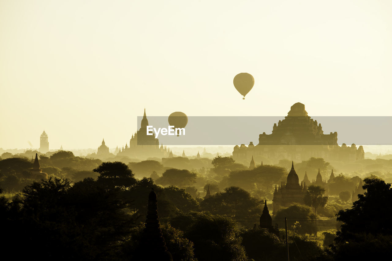 balloon, hot air balloon, sky, air vehicle, place of worship, building exterior, travel destinations, architecture, belief, built structure, travel, religion, tourism, history, the past, spirituality, plant, nature, no people, ancient civilization, outdoors, spire