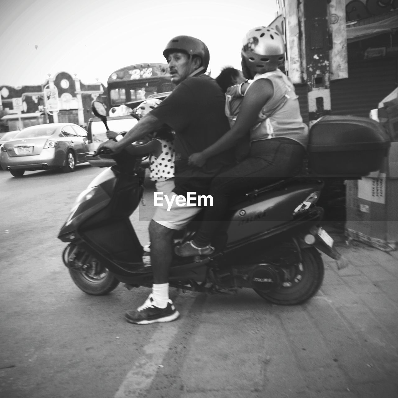 transportation, land vehicle, mode of transport, street, full length, building exterior, car, two people, built structure, architecture, motorcycle, outdoors, stationary, real people, city, young adult, day, young women, sitting, city life, lifestyles, bicycle, men, women, togetherness, scooter, people
