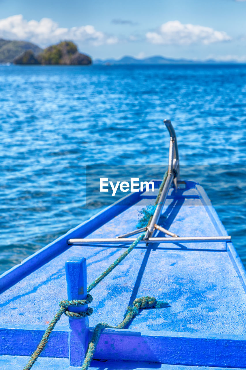 water, nautical vessel, sea, transportation, blue, mode of transportation, no people, day, cloud - sky, nature, sky, outdoors, beauty in nature, oar, tranquil scene, moored, scenics - nature, rippled, fishing boat, rowboat