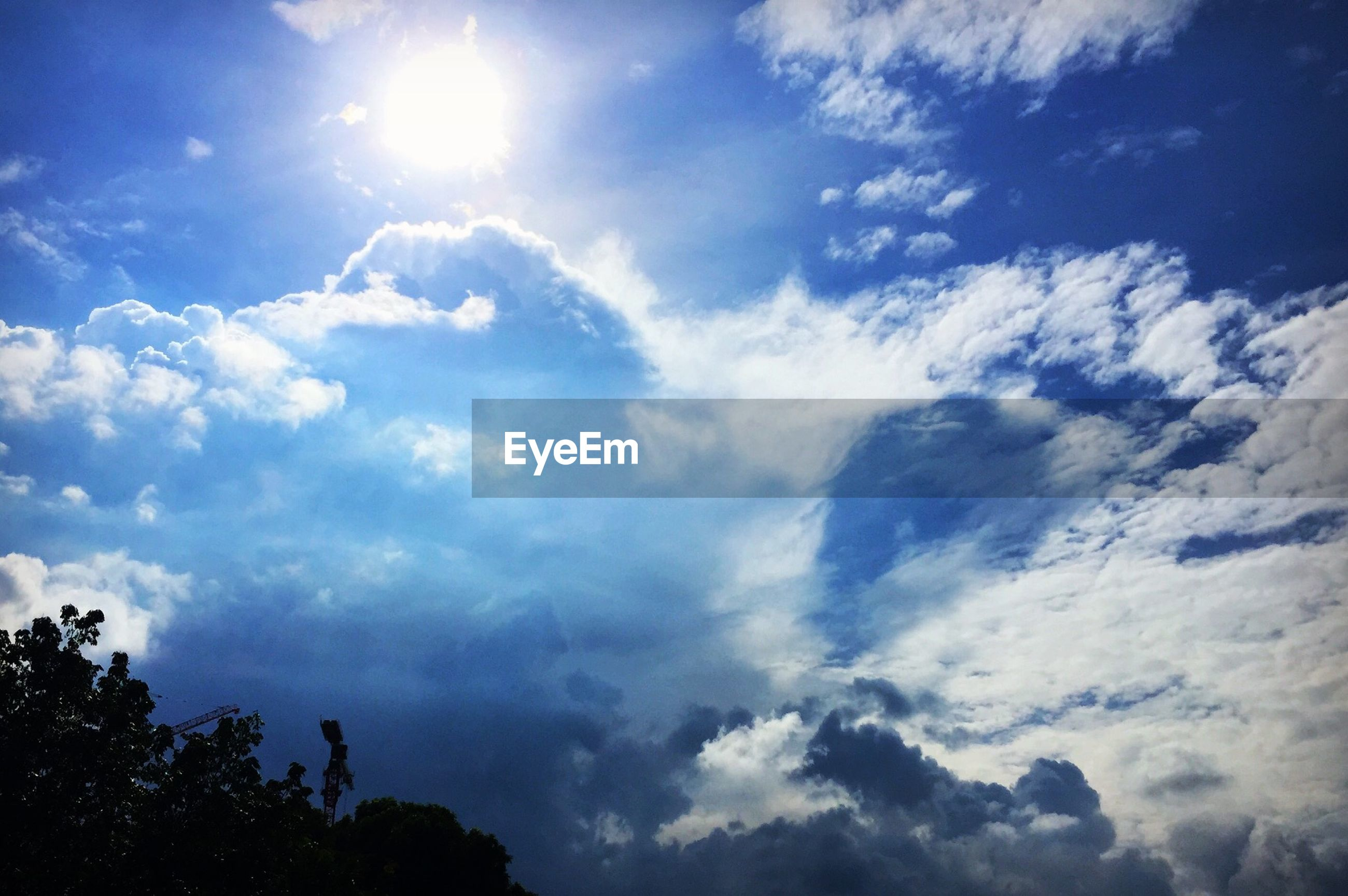 Low angle view of cloudy sky during sunny day