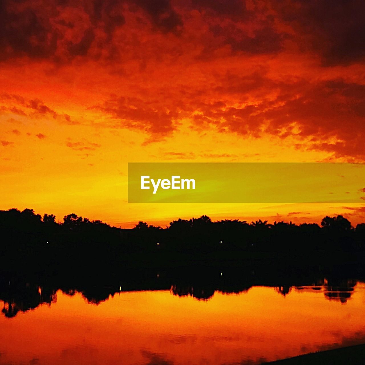 sunset, orange color, silhouette, nature, beauty in nature, tranquil scene, scenics, sky, tranquility, tree, reflection, outdoors, no people, water, cloud - sky