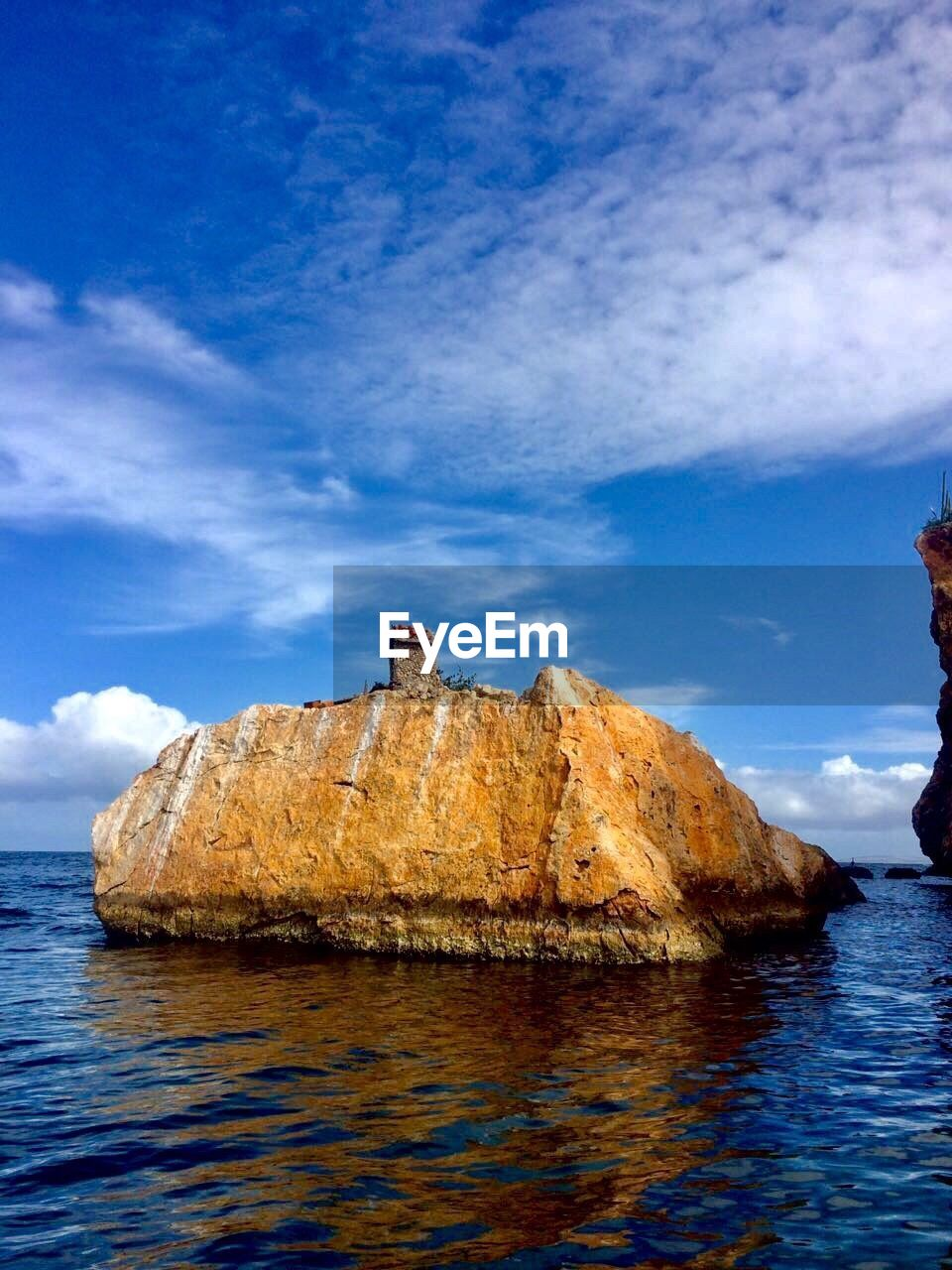 rock - object, sea, nature, rock formation, sky, water, tranquility, scenics, beauty in nature, tranquil scene, outdoors, cloud - sky, day, waterfront, horizon over water, cliff, blue, no people