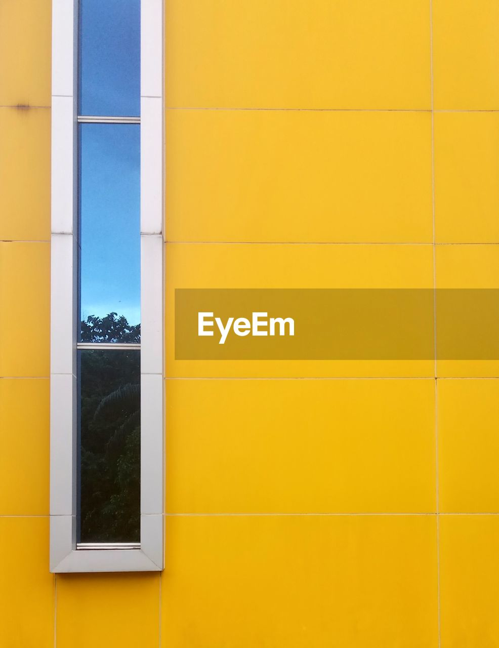 architecture, built structure, wall - building feature, building exterior, yellow, building, no people, day, full frame, copy space, pattern, window, backgrounds, modern, glass - material, flooring, outdoors, multi colored, reflection, close-up